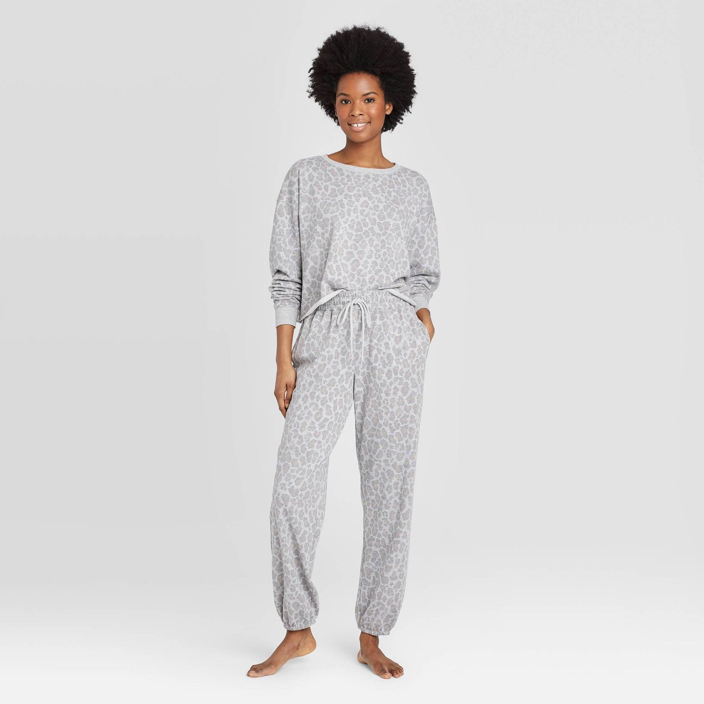 Slip into one of these adorably chic and on trend Loungewear Sets and Matching Sweatsuits, look cute as could be from the comfort of your sofa, and and stay on budget. These adorable and under $50 cozy and chic sets will get you through the season in total comfort! | glitterinc.com | @glitterinc // Colsie Women's Leopard Print Cropped Lounge Sweatshirt + Colsie Women's Leopard Print Jogger Pants