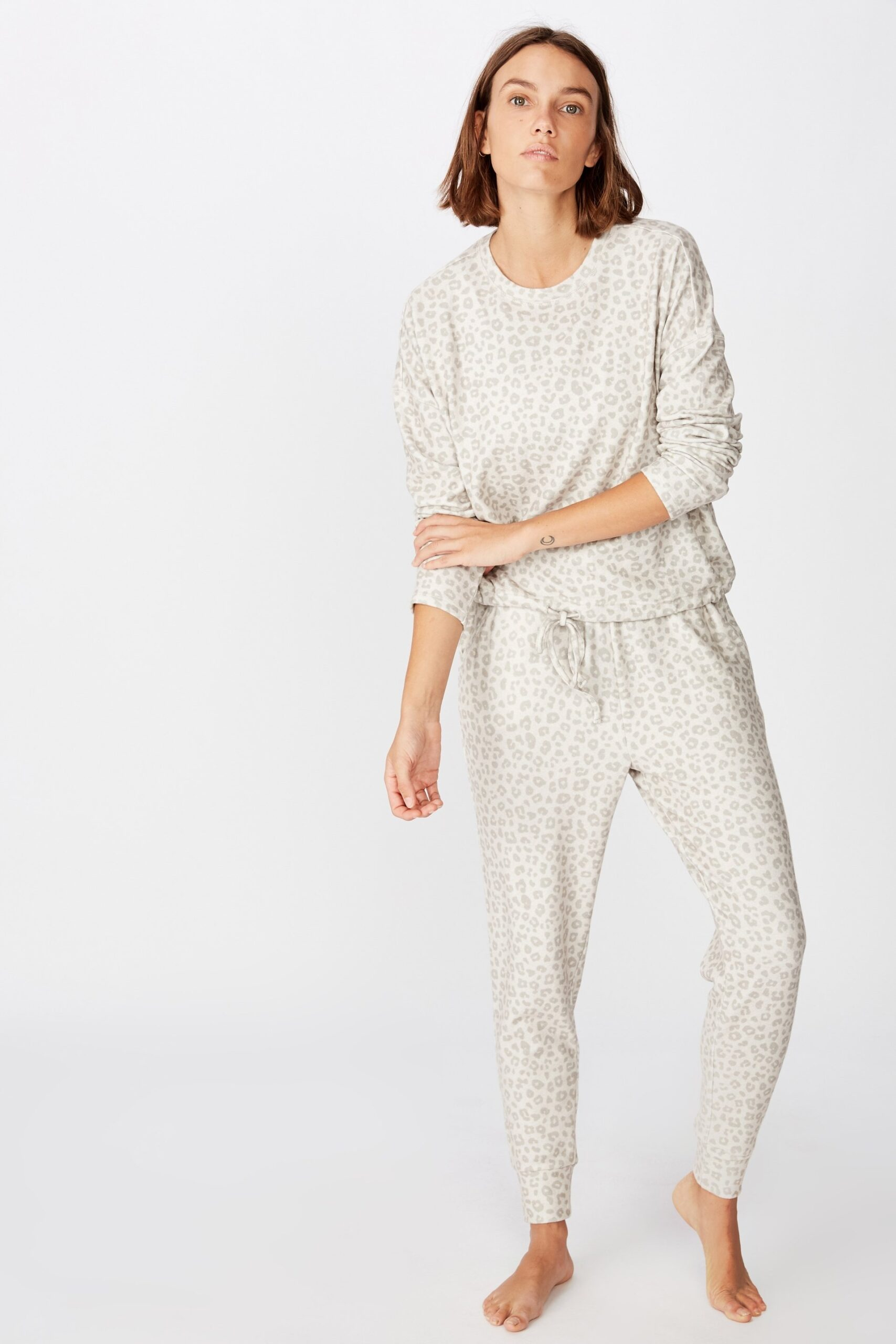 Slip into one of these adorably chic and on trend Loungewear Sets and Matching Sweatsuits, look cute as could be from the comfort of your sofa, and and stay on budget. These adorable and under $50 cozy and chic sets will get you through the season in total comfort! | glitterinc.com | @glitterinc // Cotton On Body Supersoft Slim Fit Pant in Tonal Animal