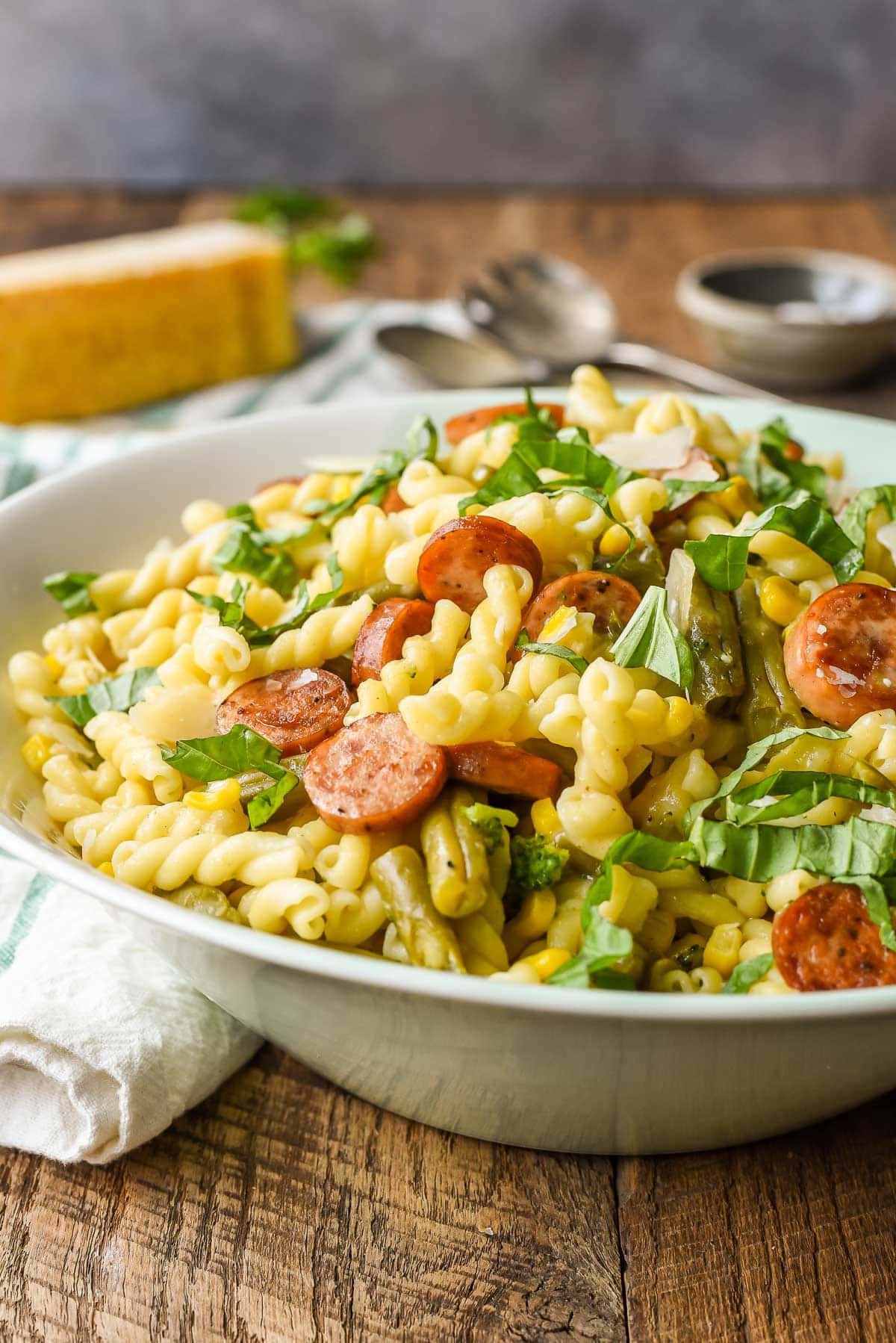 These family-friendly meals use pantry ingredients like beans, lentils, canned goods, pasta, rice, and broth, plus or minus staples that keep well in the freezer or refrigerator. These flexible recipes are all about using what you have on hand to make easy, delicious lunches and dinners! | glitterinc.com | @glitterinc // Easy Parmesan Pasta with Chicken Sausage and Canned Vegetables