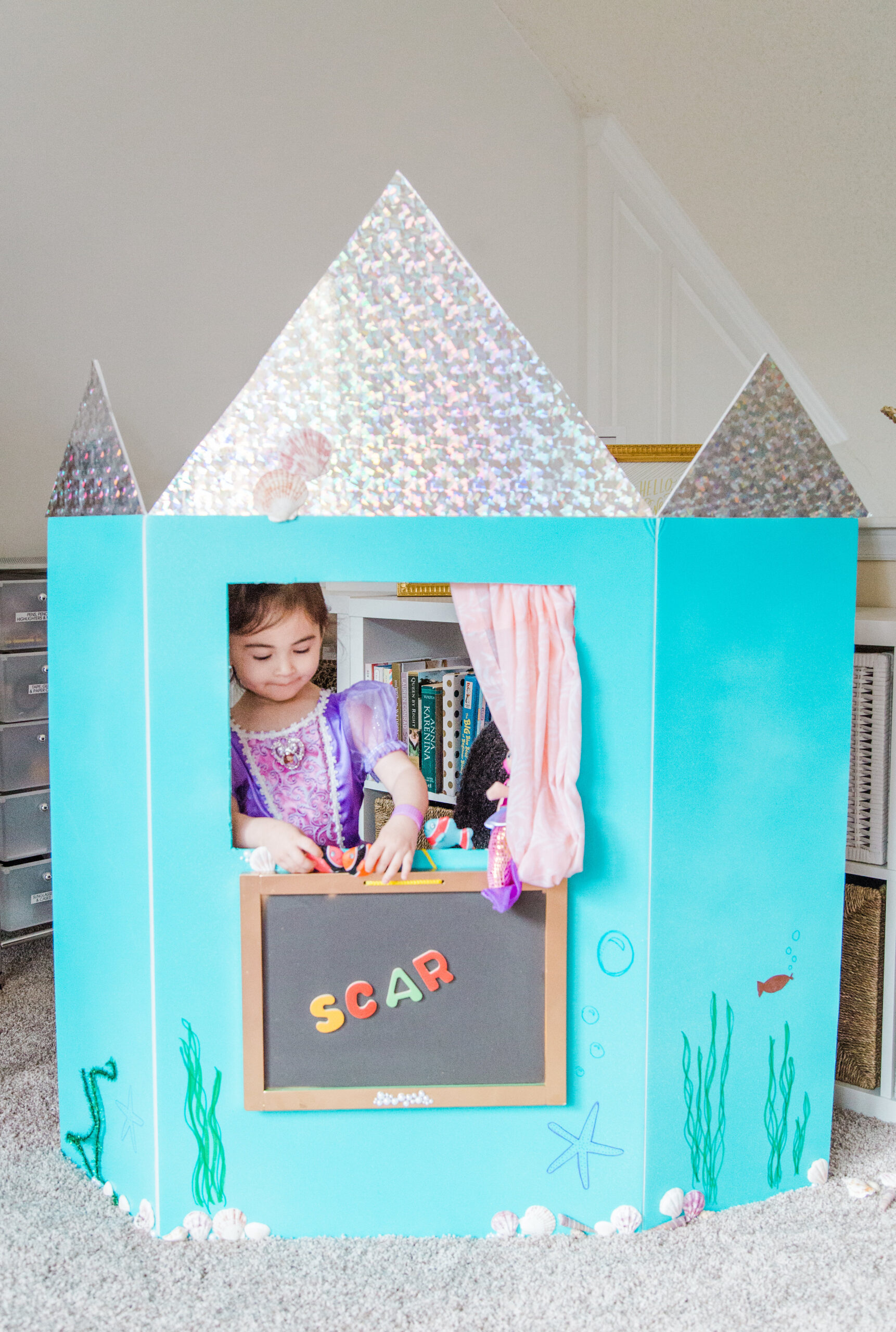 Home with your young kids? Here is a huge list of fun and educational activities to do at home with young kids, including exactly how to entertain your children during school closures, cold and flu days, Spring and Summer vacation breaks, and more. | glitterinc.com | @glitterinc // How to Make a Learning Puppet Theatre - puppet show theater - GLITTERINC.COM