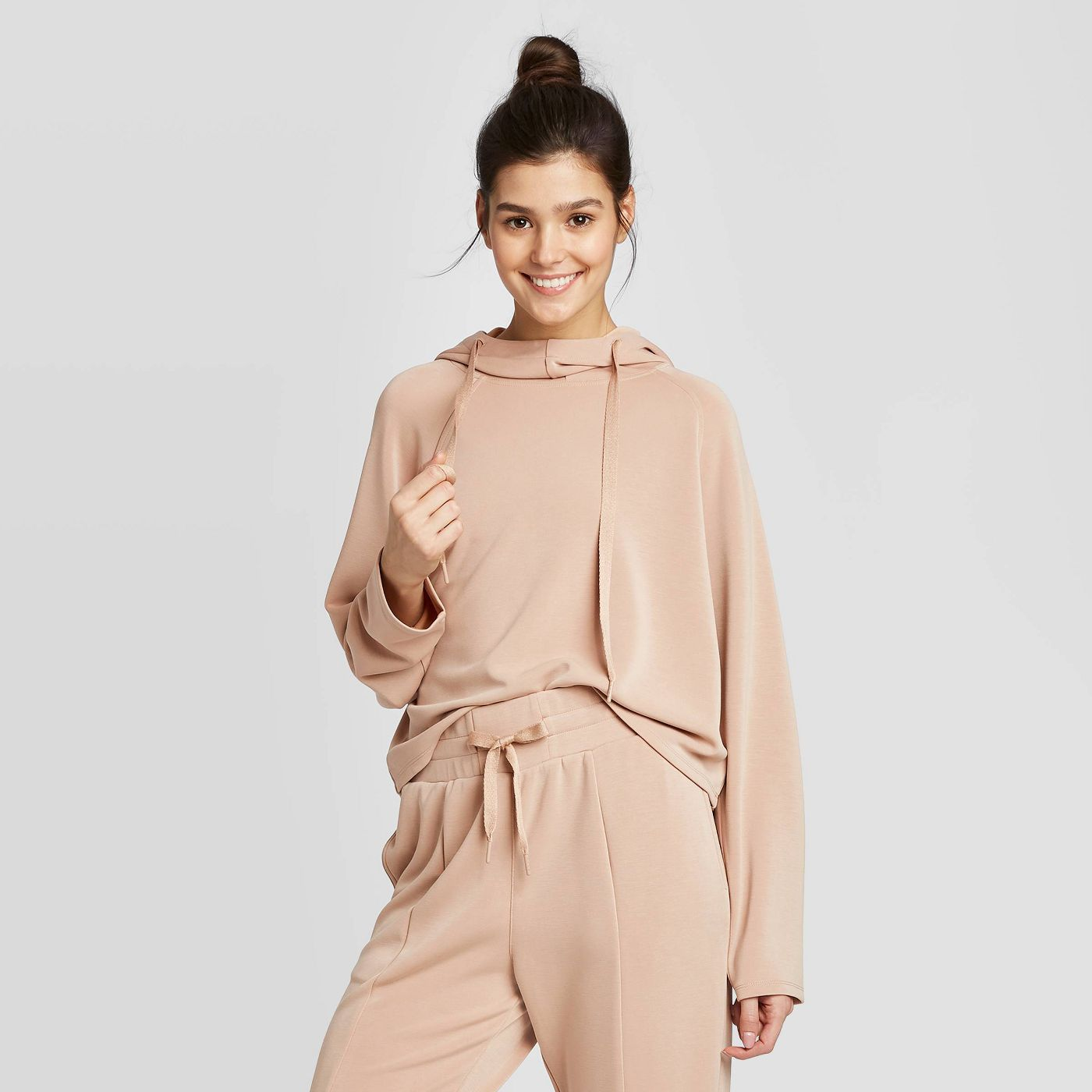 Slip into one of these adorably chic and on trend Loungewear Sets and Matching Sweatsuits, look cute as could be from the comfort of your sofa, and and stay on budget. These adorable and under $50 cozy and chic sets will get you through the season in total comfort! | glitterinc.com | @glitterinc // JoyLab Women's Slounge Sweatshirt + JoyLab Women's Slounge Trousers