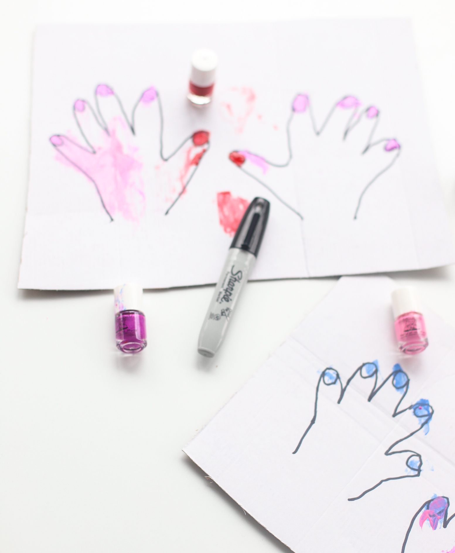 This DIY Kids Cardboard Manicure Activity is easy to set up, everything you will need you already have at home, and kids LOVE painting the pretend nails with nail polish! | glitterinc.com | @glitterinc
