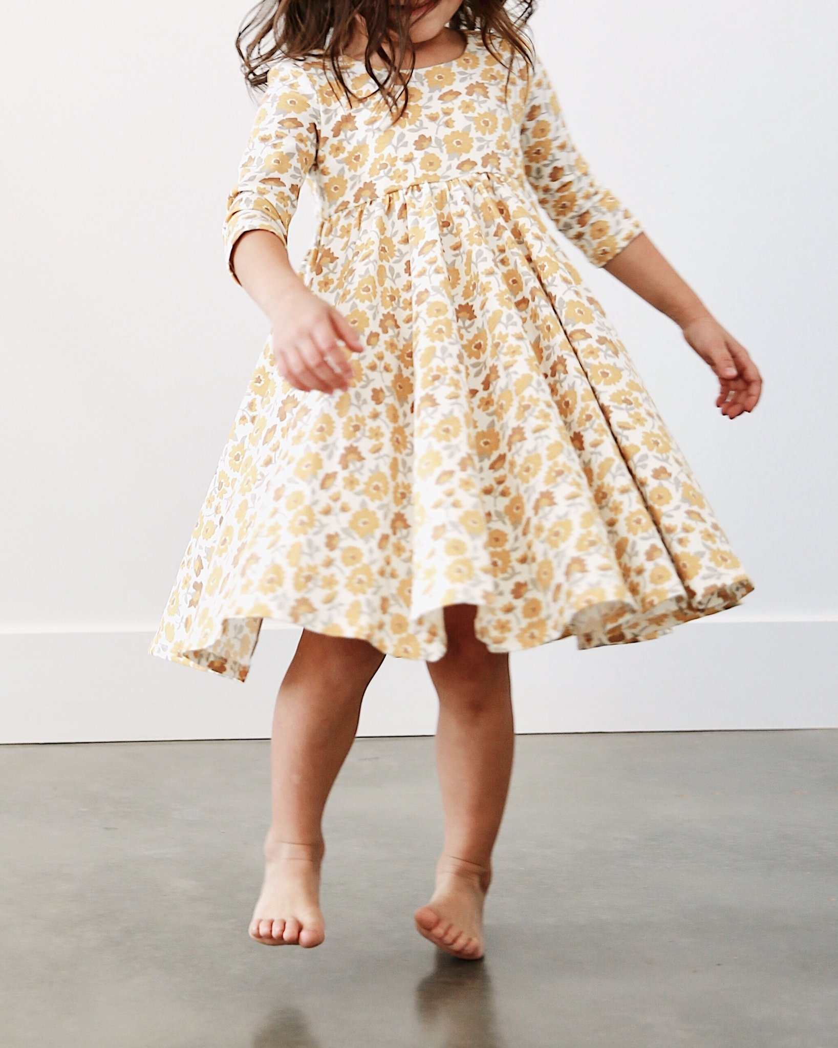 If you have a little girl who loves a great twirly dress, this post is for you! Sharing where to find the very best twirly dresses; a.k.a., skater dresses, for kids. | glitterinc.com | @glitterinc // Remie Girl Twirly Dress