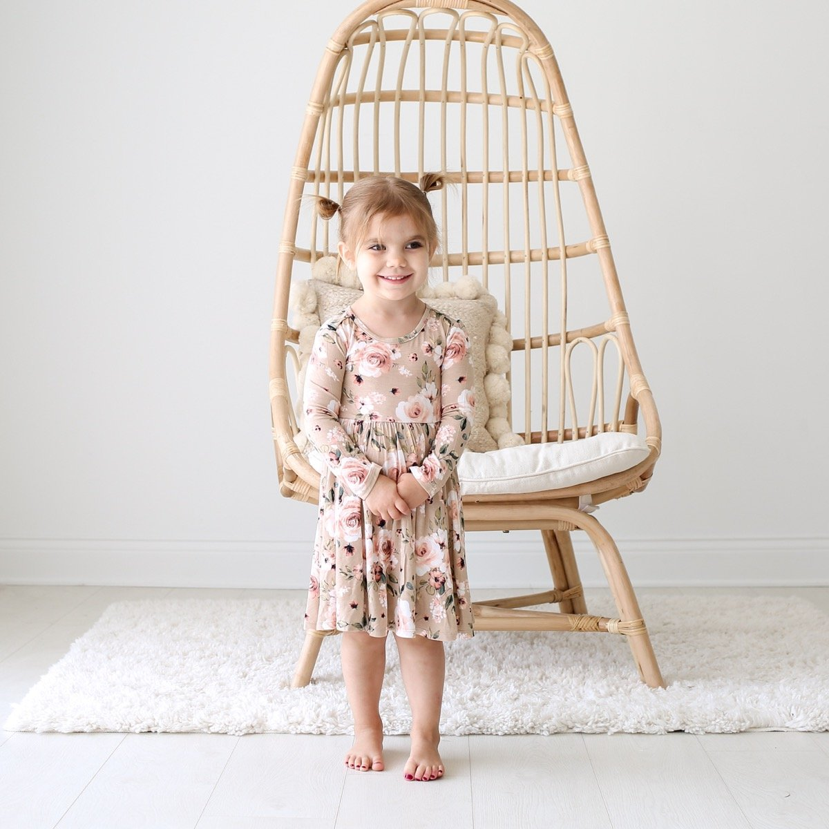 If you have a little girl who loves a great twirly dress, this post is for you! Sharing where to find the very best twirly dresses; a.k.a., skater dresses, for kids. | glitterinc.com | @glitterinc // Posh Peanut Sienna Floral Long Sleeve Twirl Dress