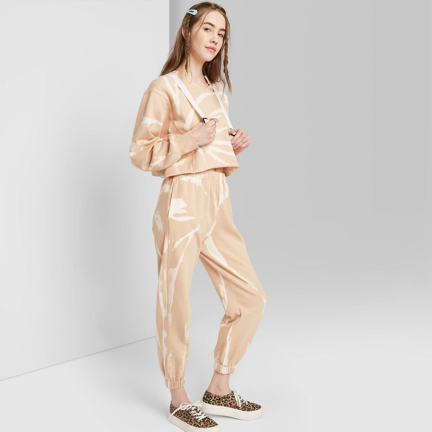Slip into one of these adorably chic and on trend Loungewear Sets and Matching Sweatsuits, look cute as could be from the comfort of your sofa, and and stay on budget. These adorable and under $50 cozy and chic sets will get you through the season in total comfort! | glitterinc.com | @glitterinc // Wild Fable Women's High-Rise Tie-Dye Sweatpants and Crop Sweatshirt