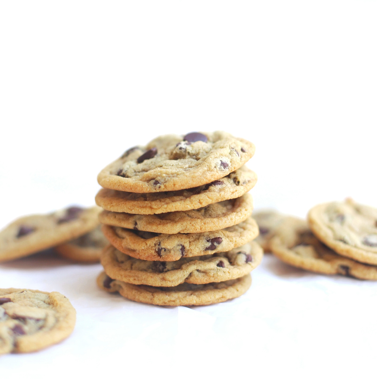 These are the very best dairy free chocolate chip cookies ever. Made in one bowl, the easy recipe results in ooey gooey, oh-so-soft, crisp and chewy, perfect chocolate chip cookies every time. Plus, we have a few tricks for making these cookies vegan and/or gluten-free too! | glitterinc.com | @glitterinc