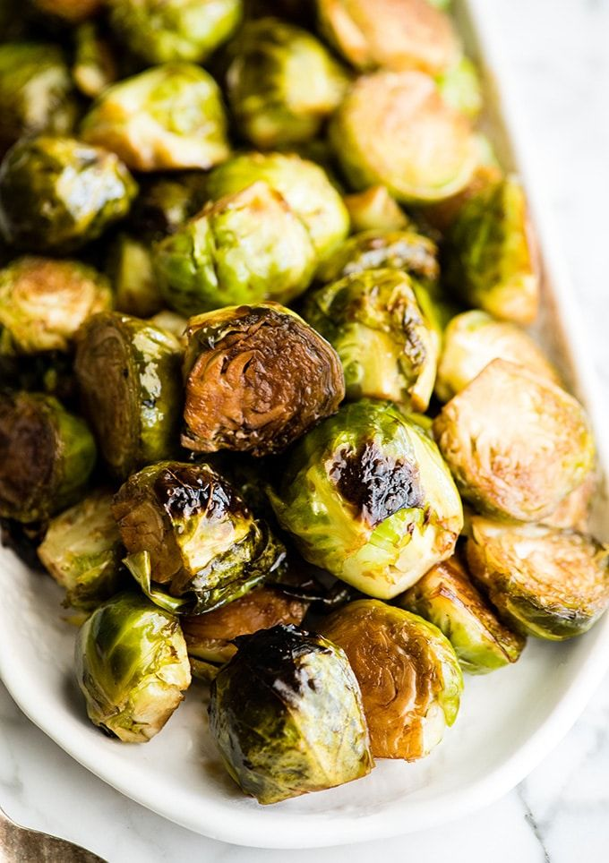 More than 100+ amazing recipes for the Jewish holiday of Passover, including a bunch of go-to, favorite Pesach recipes to make for Seder dinner, including appetizers, side dishes, and desserts, with plenty that work as great leftovers for the holiday week to follow. | glitterinc.com | @glitterinc // Balsamic Roasted Brussel Sprouts
