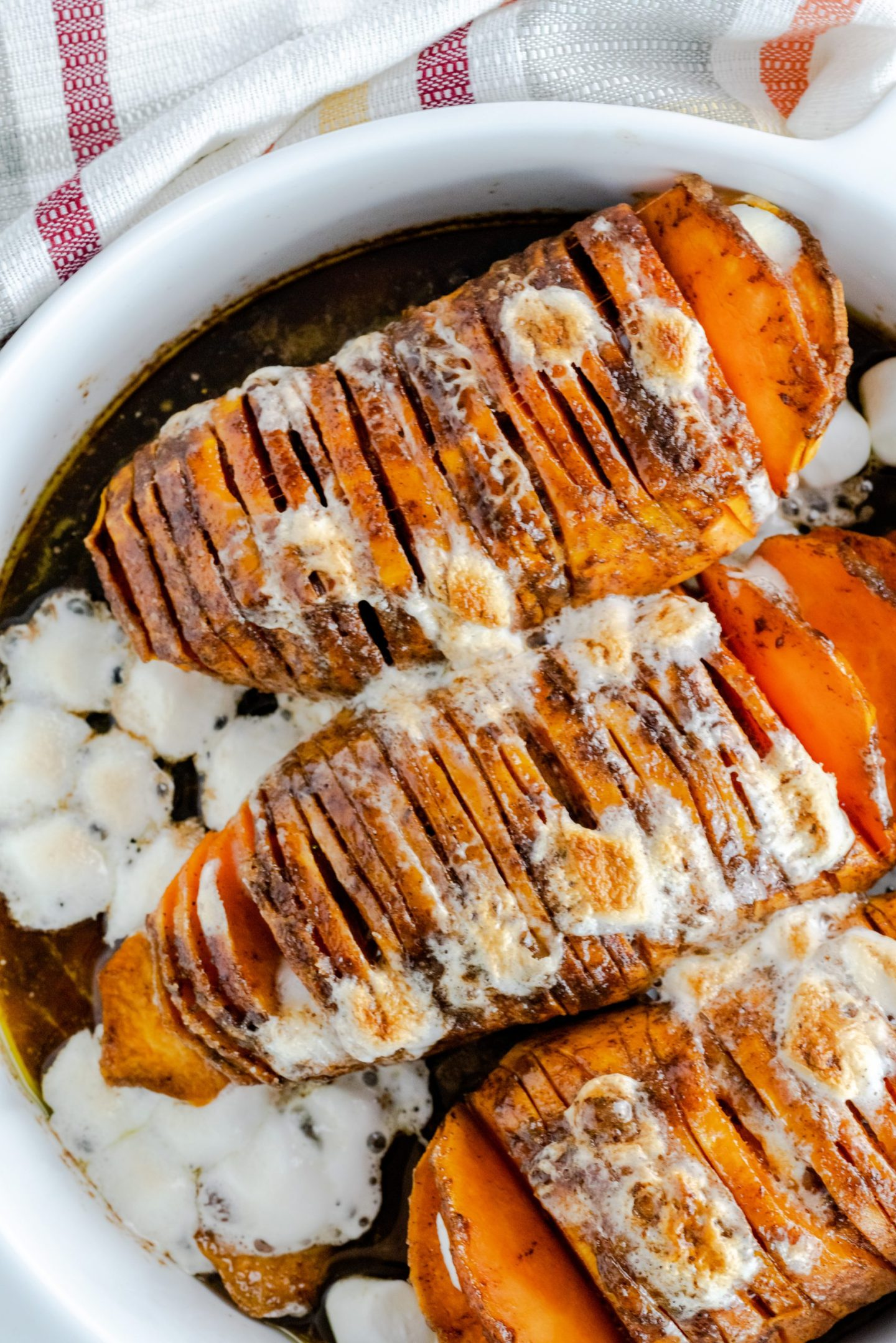 More than 100+ amazing recipes for the Jewish holiday of Passover, including a bunch of go-to, favorite Pesach recipes to make for Seder dinner, including appetizers, side dishes, and desserts, with plenty that work as great leftovers for the holiday week to follow. | glitterinc.com | @glitterinc // Hasselback Sweet Potato Casserole