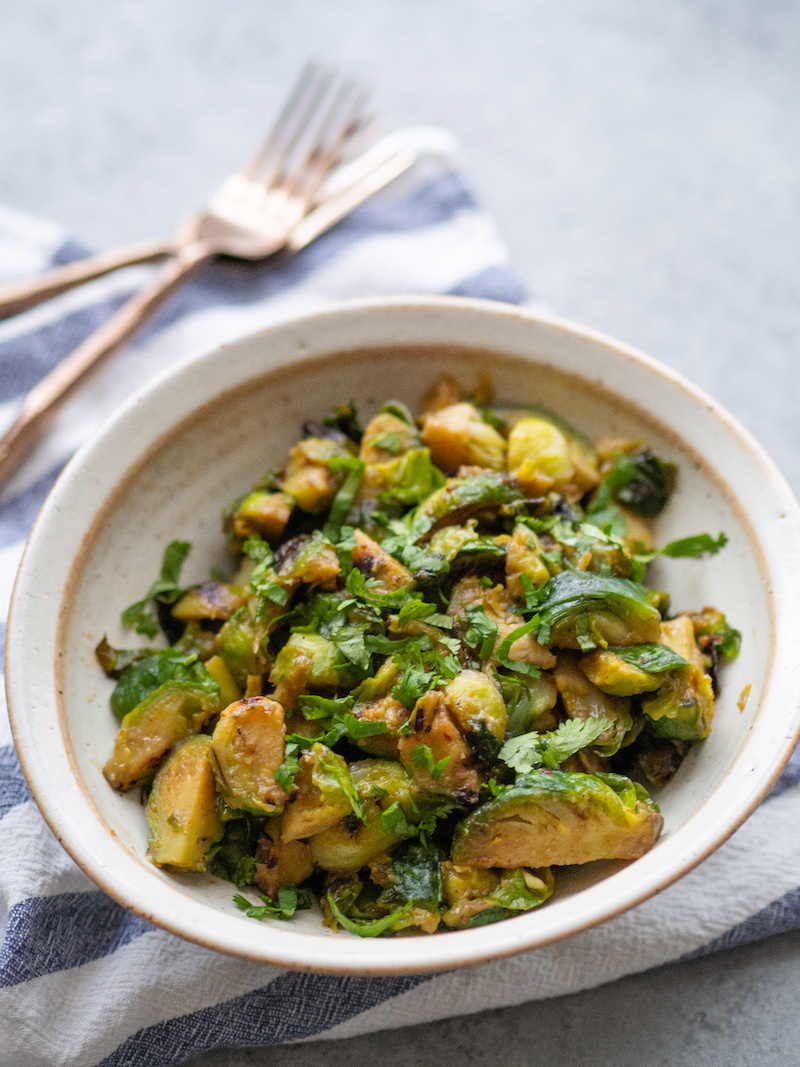 More than 100+ amazing recipes for the Jewish holiday of Passover, including a bunch of go-to, favorite Pesach recipes to make for Seder dinner, including appetizers, side dishes, and desserts, with plenty that work as great leftovers for the holiday week to follow.   glitterinc.com   @glitterinc // Easy Maple Miso Brussels Sprouts