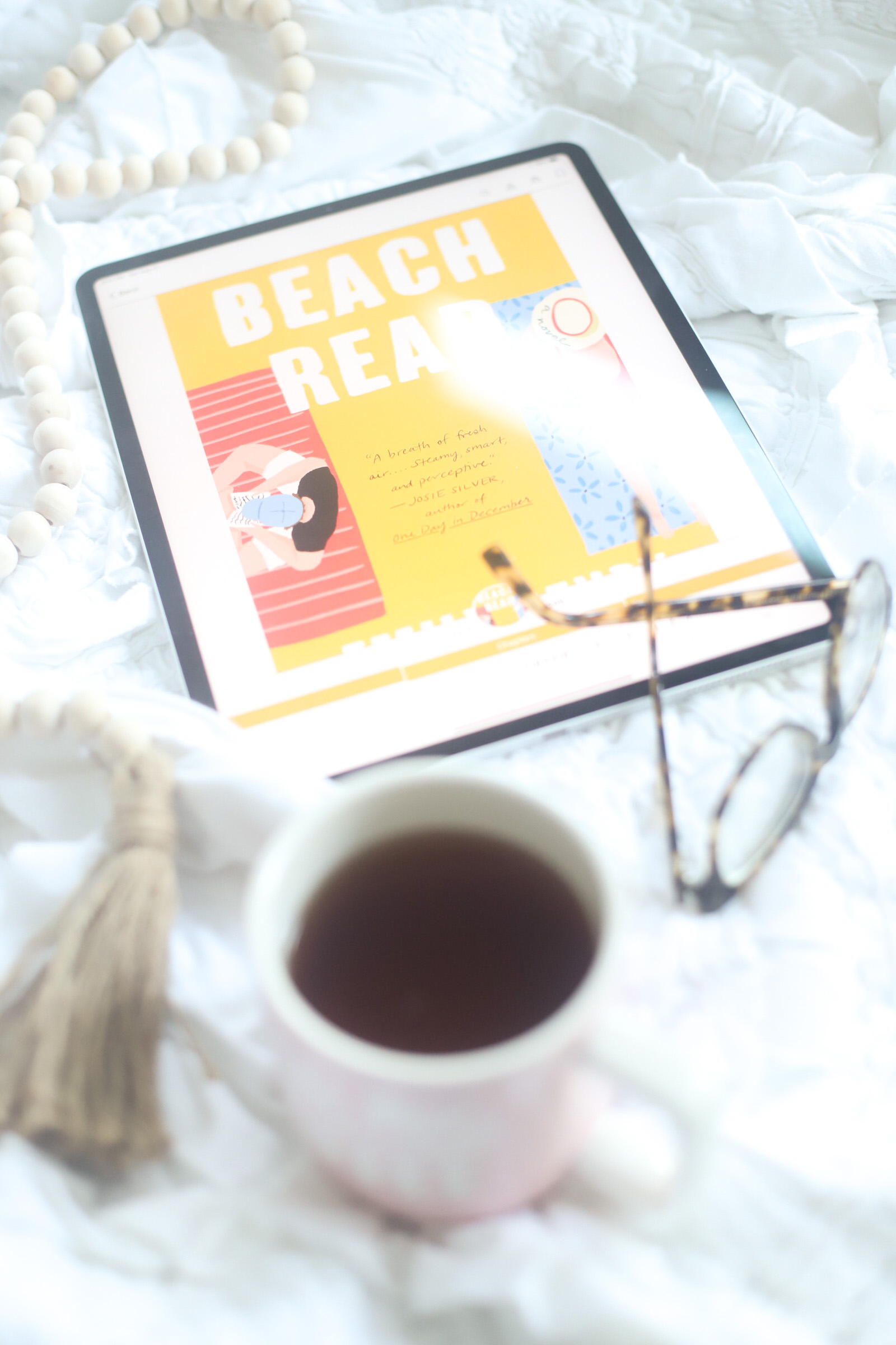 Get cozy and dive into a new romance novel with one of these 9 delightfully good romance books (that I recently read and loved!), all perfect to add to a cold weather reading list! | @glitterinclexi | GLITTERINC.COM
