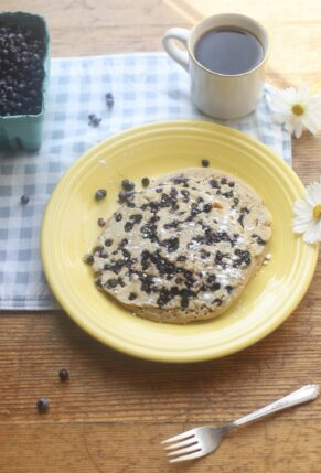 Light, fluffy, and easily our favorite pancake recipe, these birthday blueberry pancakes, bursting with fragrant Maine blueberries, are epically delicious. These pancakes are also incredible plain, with chocolate chips, or any other favorite mix-ins. (They're also the perfect celebratory pancakes!) | @glitterinclexi | GLITTERINC.COM