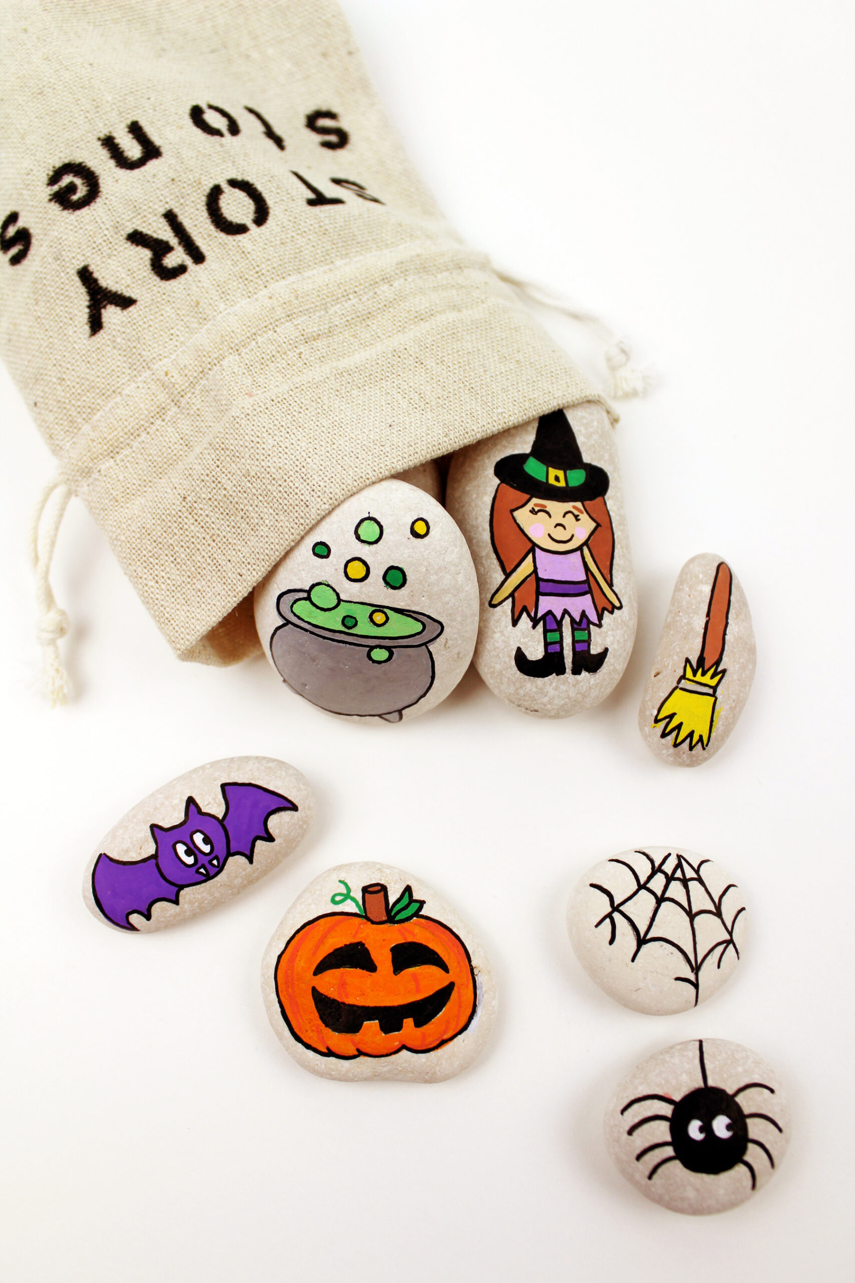 Get crafty this October and create something special with one of these 7 easy Halloween crafts and hands-on activities for toddlers and young kids! | @glitterinclexi | GLITTERINC.COM // Make Your Own Halloween Story Stones