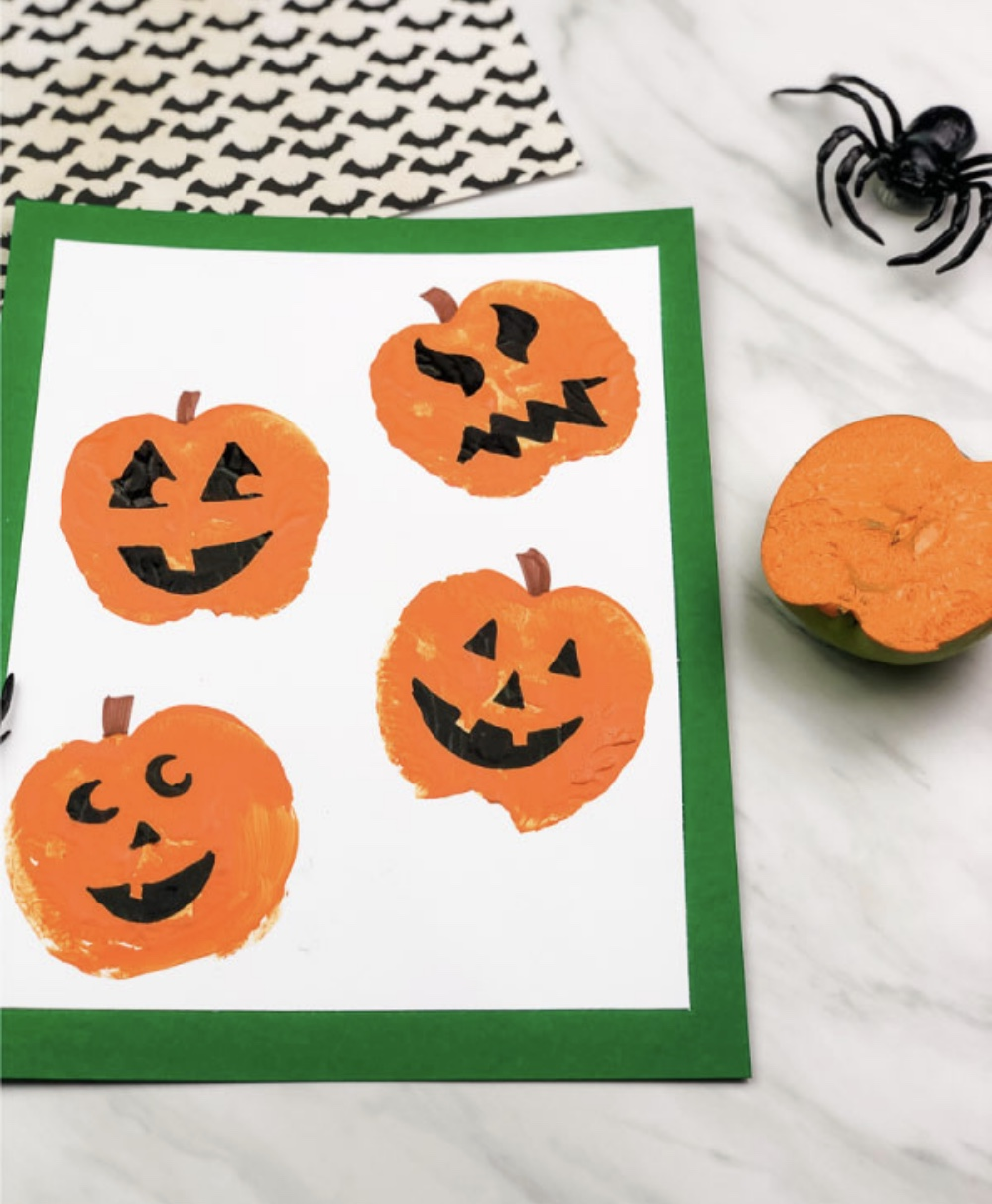 Get crafty this October and create something special with one of these 7 easy Halloween crafts and hands-on activities for toddlers and young kids! | @glitterinclexi | GLITTERINC.COM // Apple Stamp Pumpkin Craft