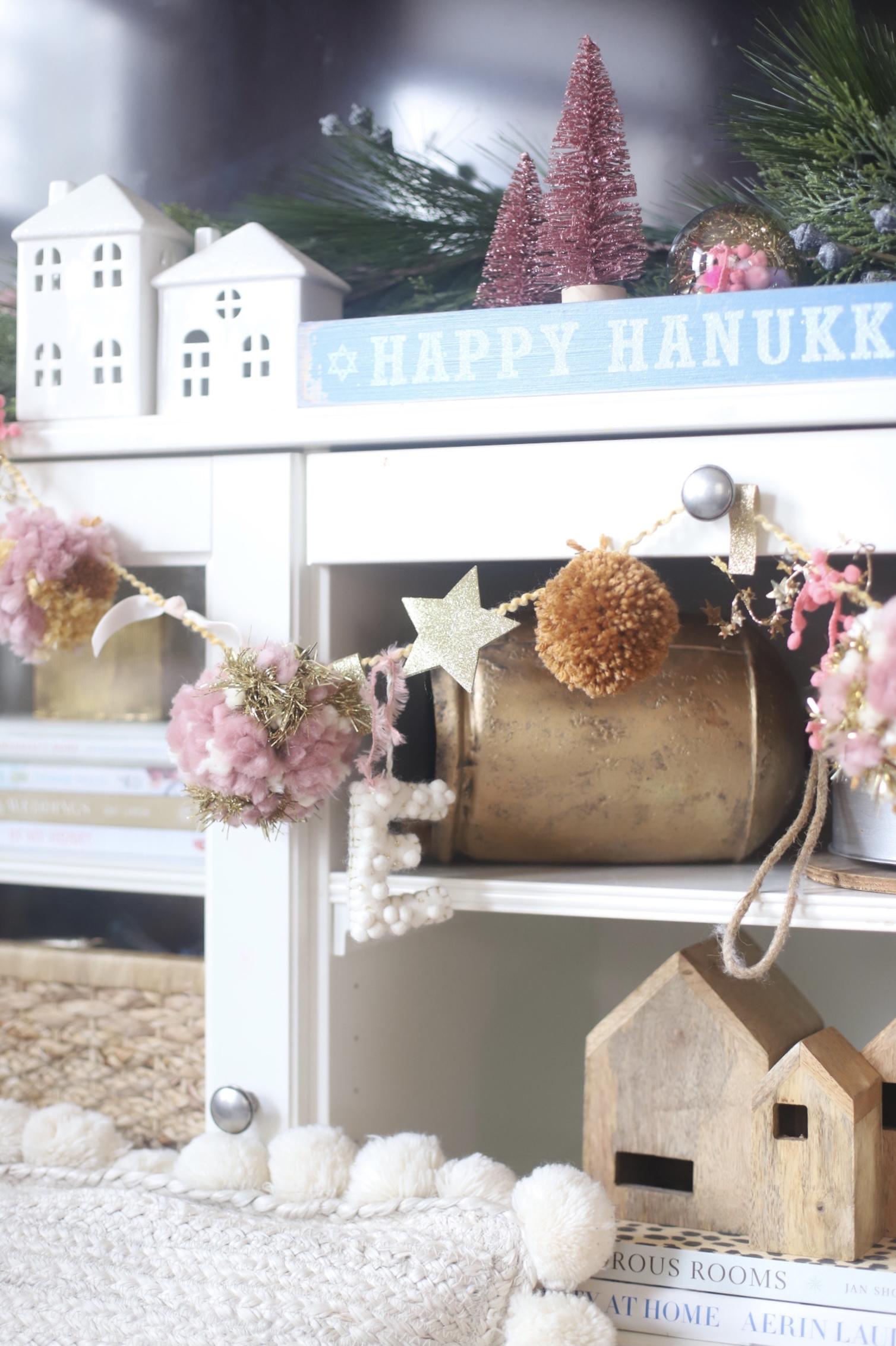 Make your own boutique-worthy DIY festive embellished pom pom garland; a.k.a., a glammed up pom pom garland with a whole lot of pizazz.| @glitterinclexi | GLITTERINC.COM