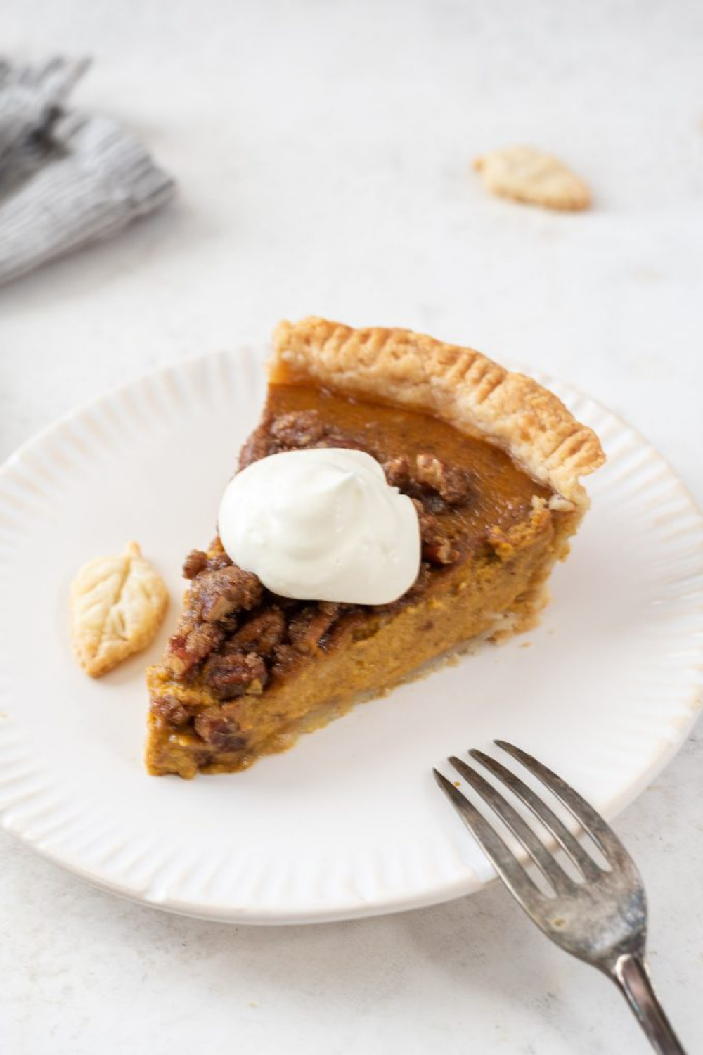 Pumpkin Pecan Pie is a buttery, flaky pie crust filled with creamy pumpkin filling and topped with a sweet, crunchy pecan streusel. This is an easy, make ahead pie that's perfect for the holidays!