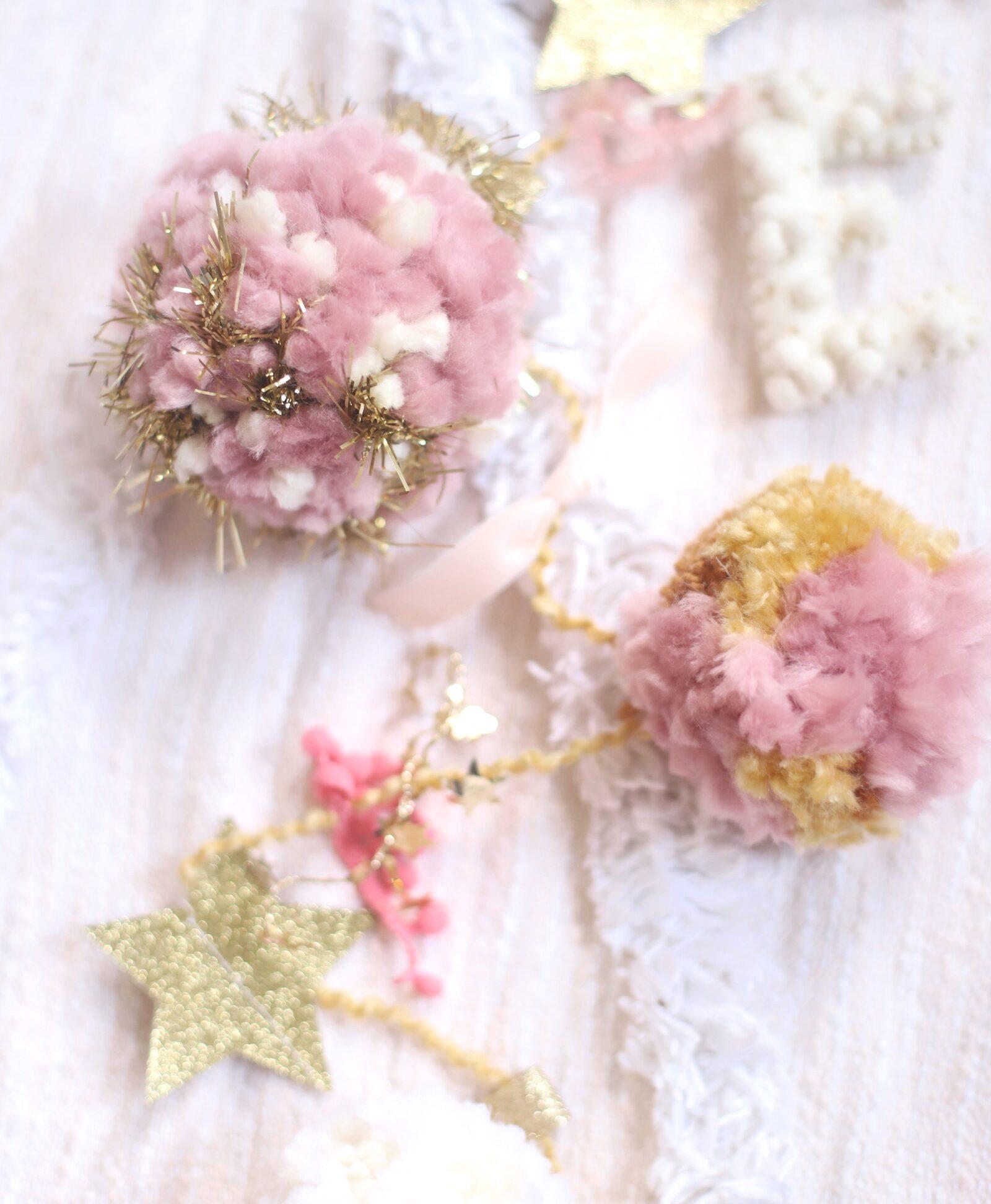 Make your own boutique-worthy DIY festive tinsel, ribbon, and glitter stars pom pom garland; a.k.a., a glammed up pom pom garland with a whole lot of pizazz.| @glitterinclexi | GLITTERINC.COM