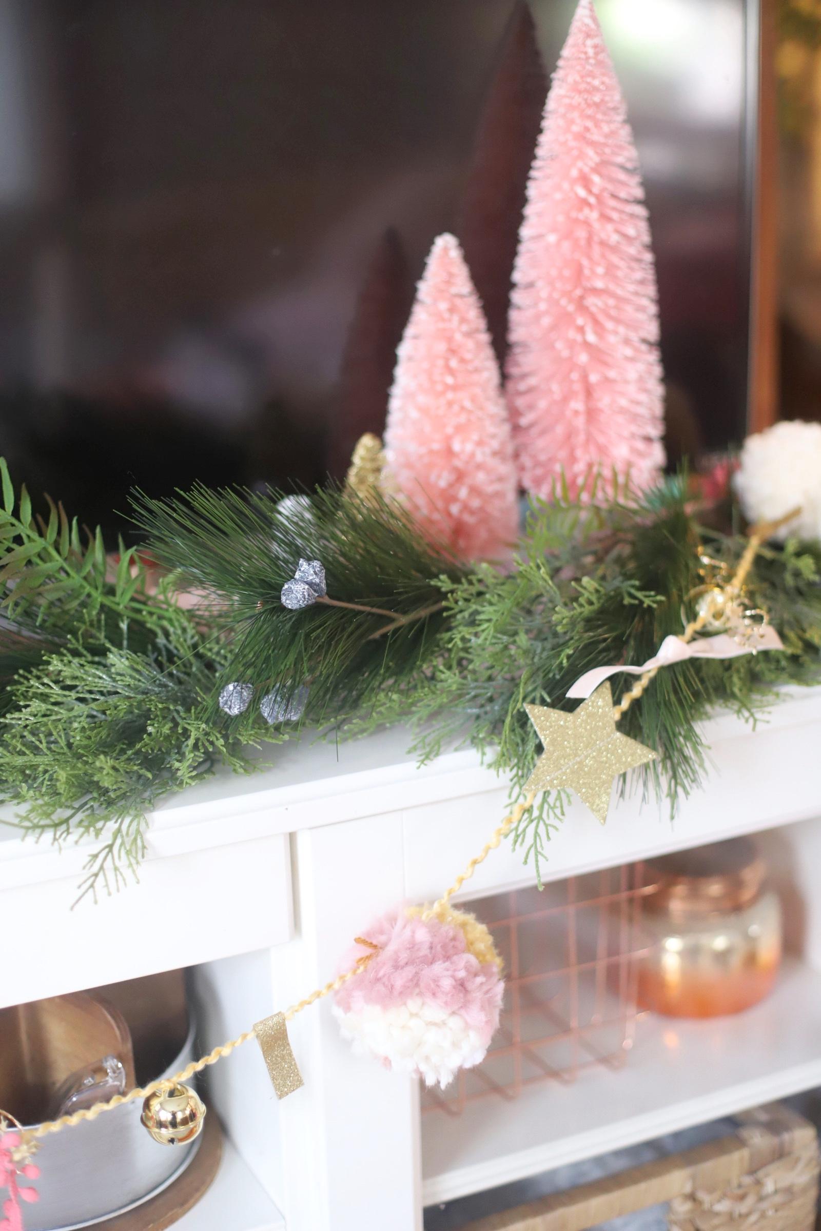 Make your own boutique-worthy DIY EMbellished pom pom garland with festive tinsel, ribbon, washi ape, and glitter stars; a.k.a., a glammed up pom pom garland with a whole lot of pizazz.| @glitterinclexi | GLITTERINC.COM