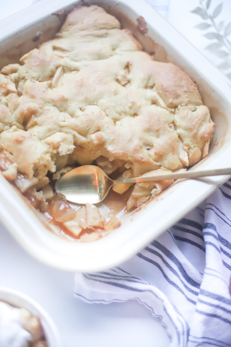 This deceptively delicious apple cobbler is rich, full of cinnamon, fragrant apples, and a velvety caramel sauce, topped with the most heavenly dough, and yet, is actually lower calorie than a traditional cobbler and can also be made dairy-free! GLITTERINC.COM