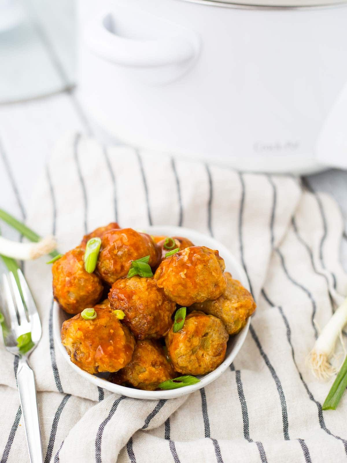 Perfect for parties or a busy weeknight, these turkey enchilada slow cooker meatballs are easy to make, healthy, and so flavorful!