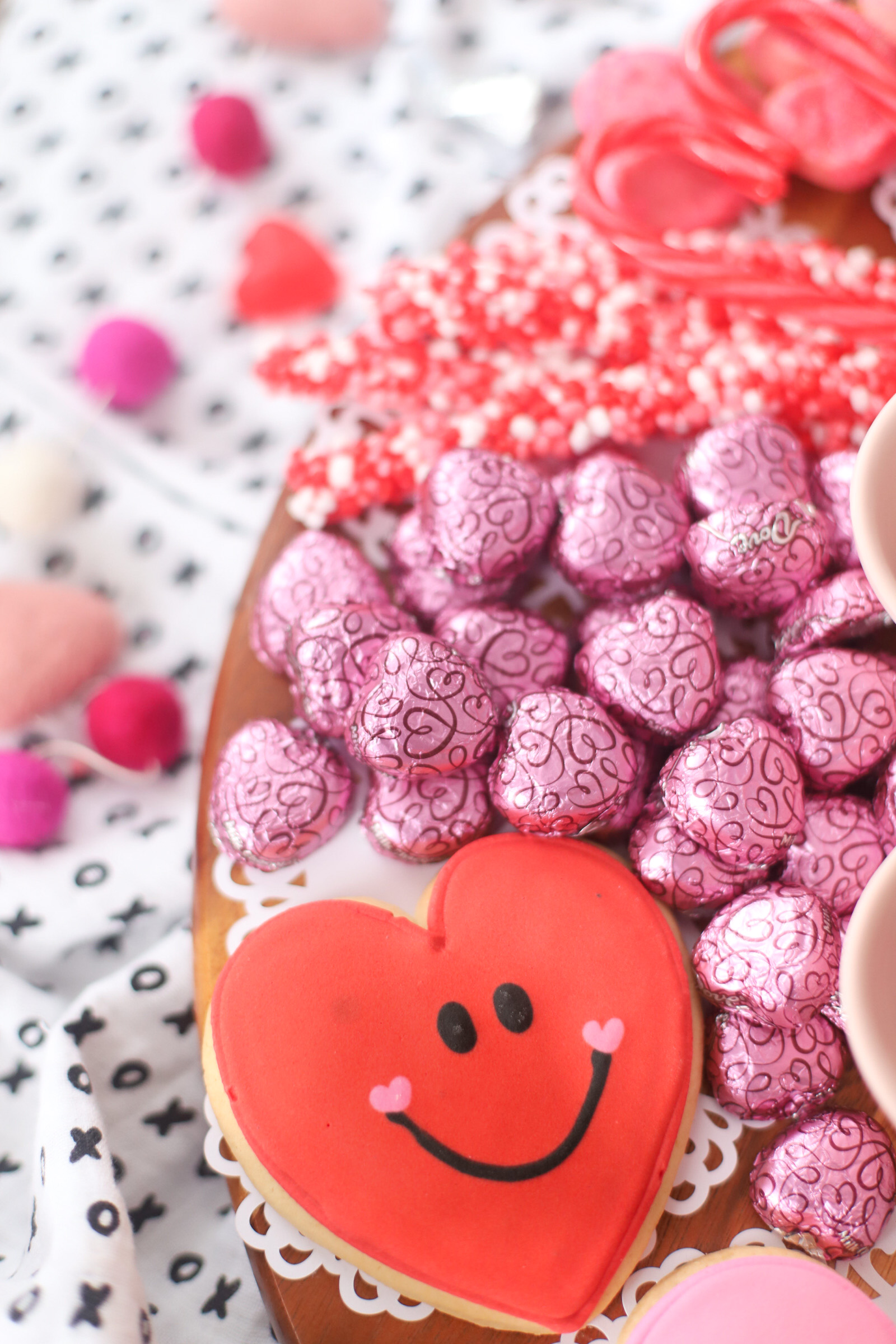 The Valentine's Day dessert board is a spin on the traditional charcuterie, only this spread features nothing but dessert! Piled high with chocolates, candies, and cookies, this is the dessert spread of your sweet tooth dreams. No cooking required! | @glitterinclexi | GLITTERINC.COM