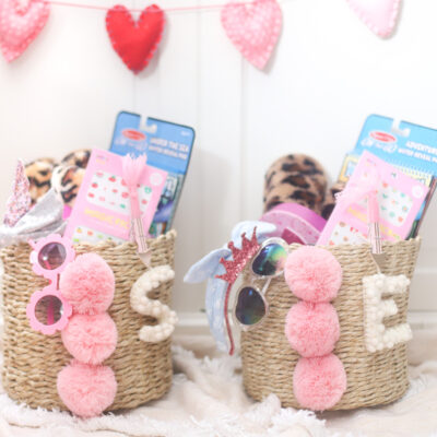 This Valentine's Day, put together an adorable basket of love for your kids! We're sharing everything we put in this year's Valentine's Day pom pom baskets for our girls. | @glitterinclexi | GLITTERINC.COM