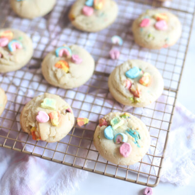 The best and most unbelievably perfect dairy free sugar cookies, filled and topped with Lucky Charms marshmallows, plus a soft, thick, and chewy interior; these festive pillowy sugar cookies are a deliciously adorable recipe for a St. Patrick's Day treat.| @glitterinclexi | GLITTERINC.COM