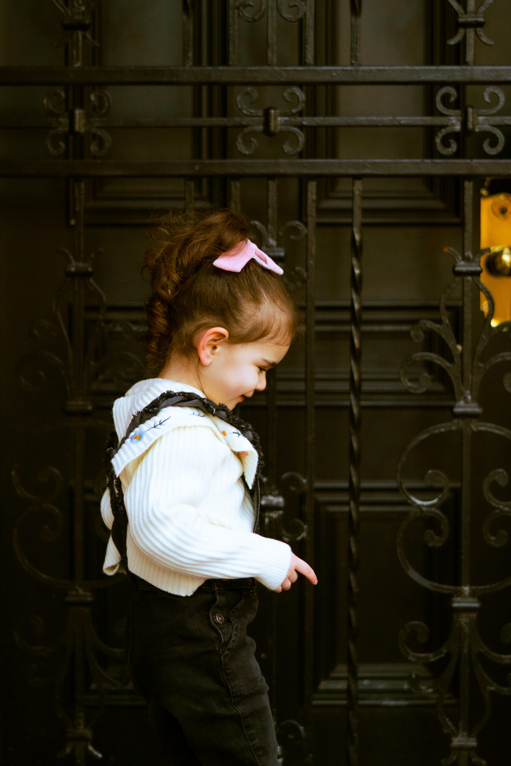 a little girl outside showing the way Living in a Big City With Young Kids