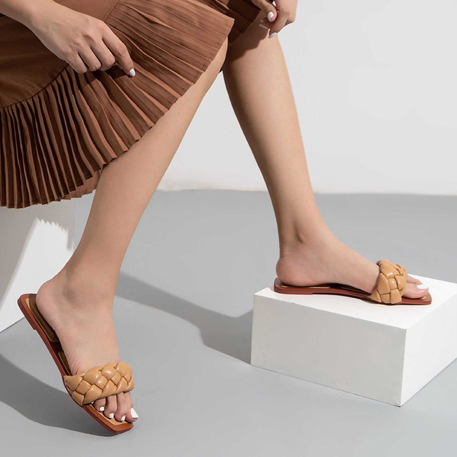 Woman wearing Square Open Toe Flat Sandals Comfortable Slip On Mule Slides Sandals with Braided Strappy Slipper Casual Shoes