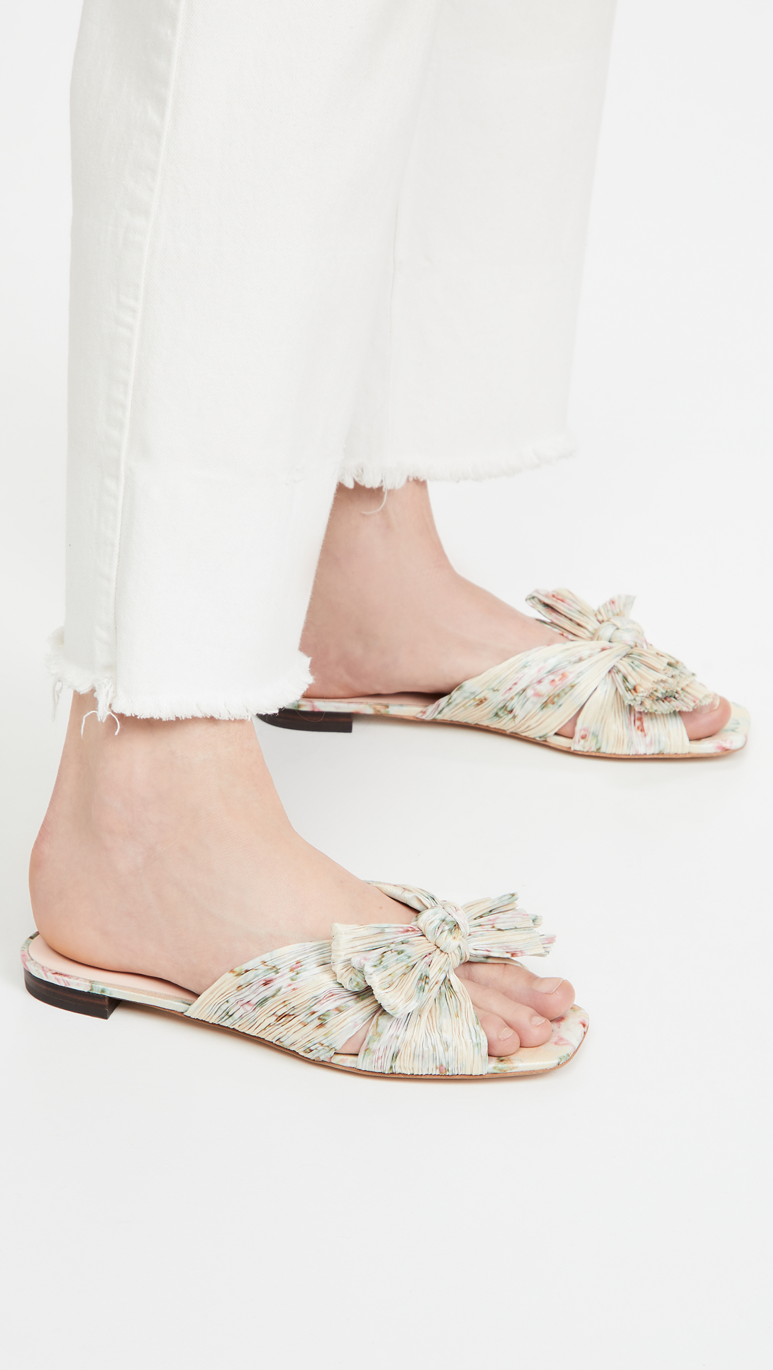 woman wearing Loeffler Randall Daphne Flat Sandals and white jeans