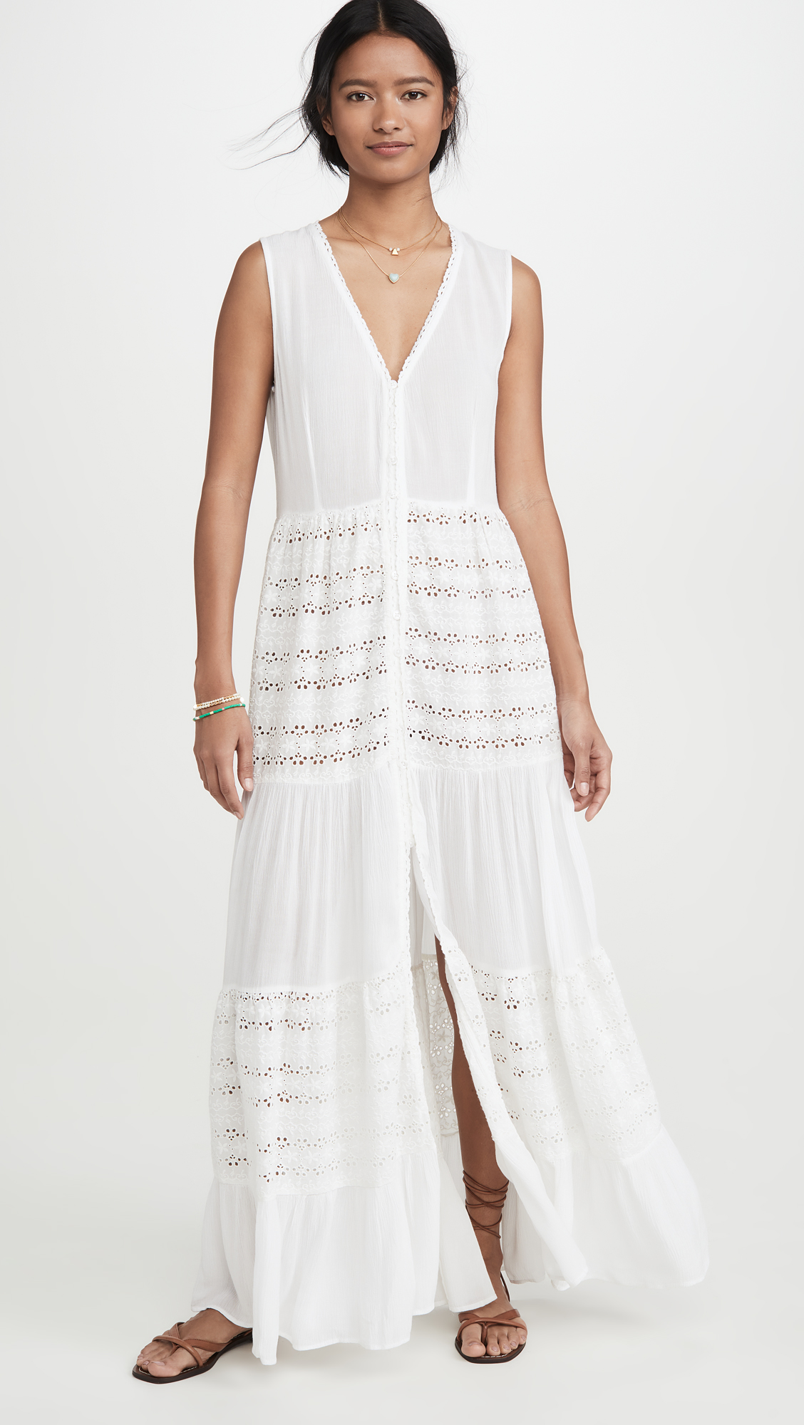 woman wearing Playa Lucila Eyelet white Maxi Dress and flat sandals