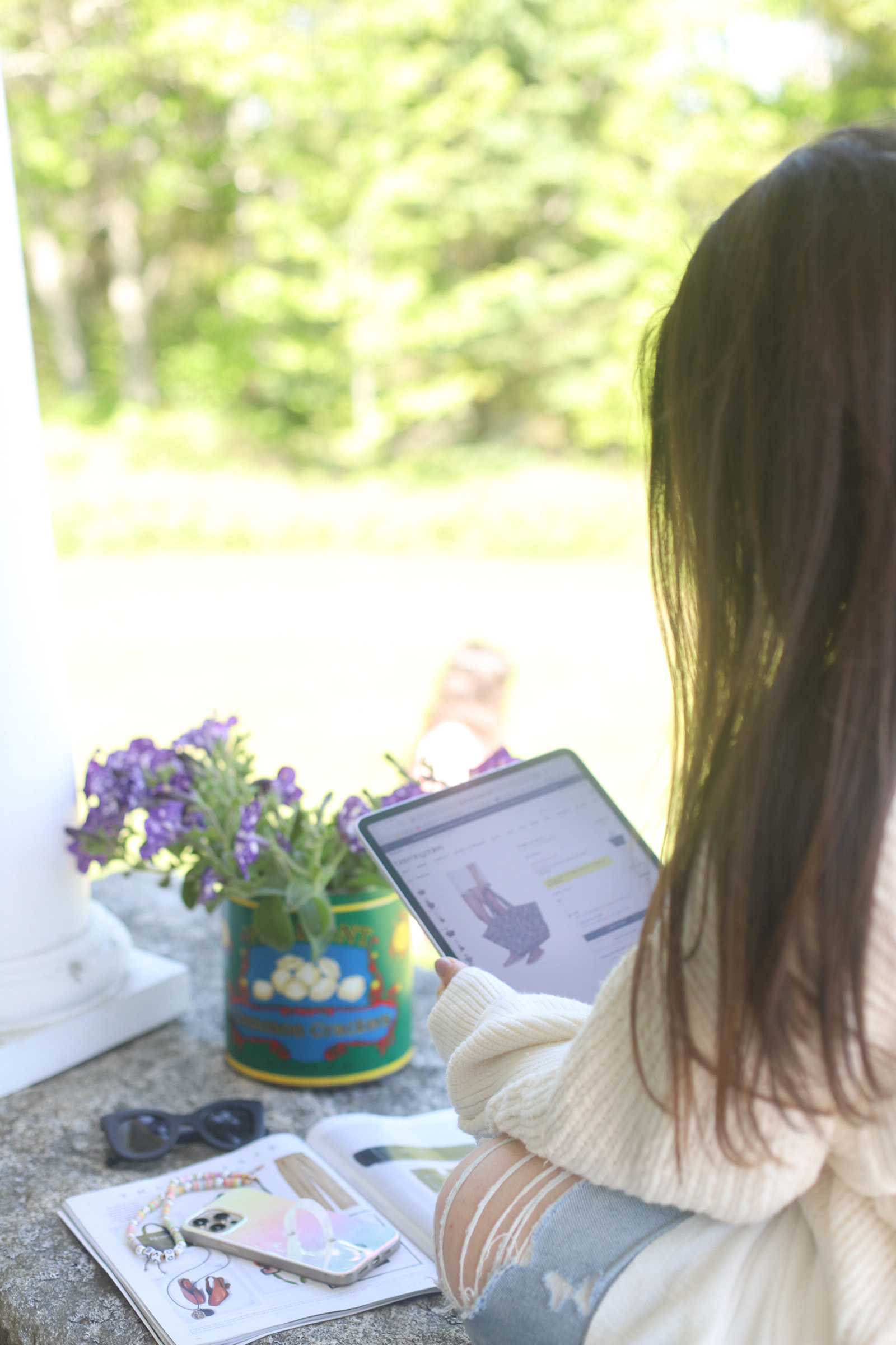 woman doing The Best Memorial Day Weekend Sales online shopping