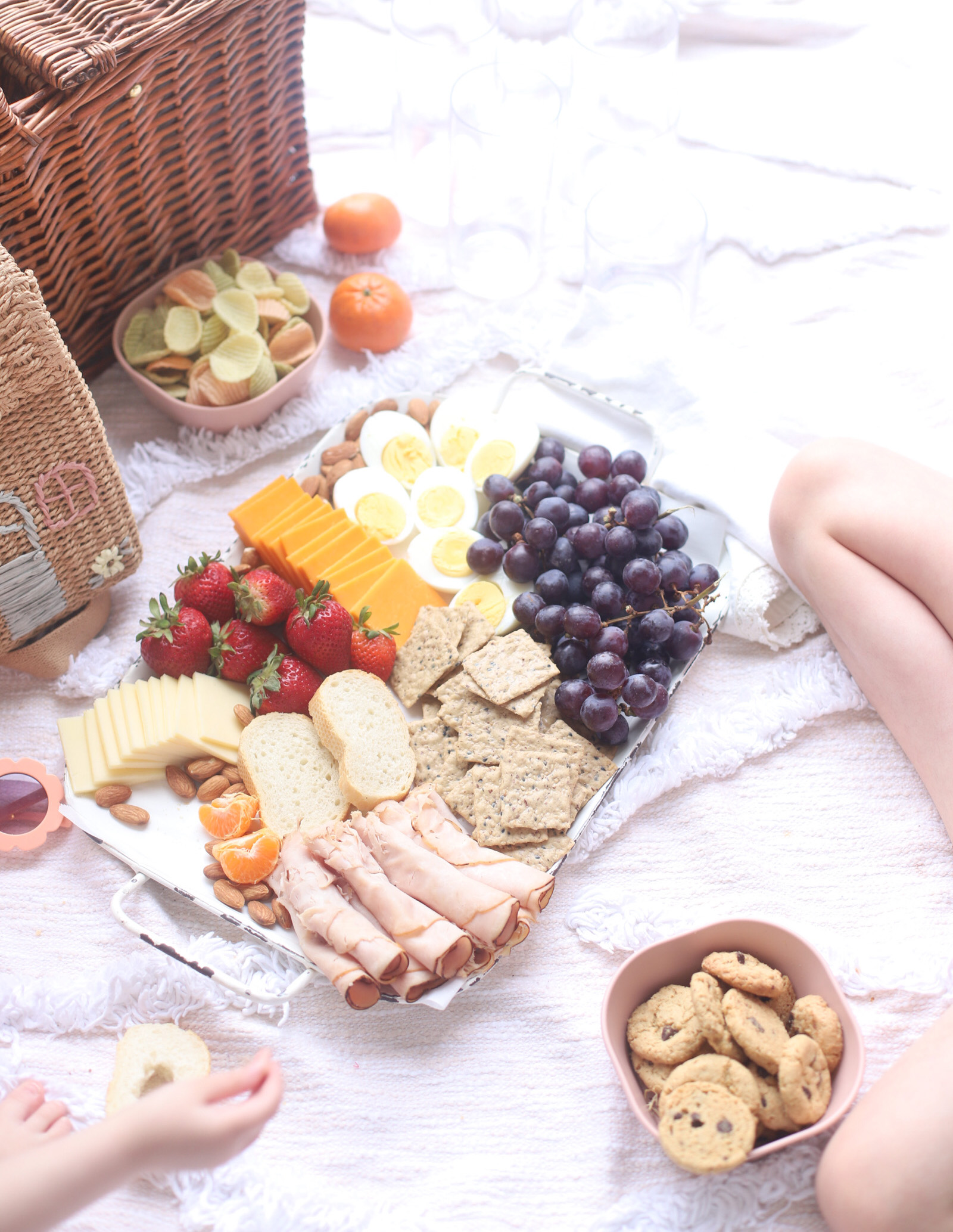 charcuterie board and a picnic basket