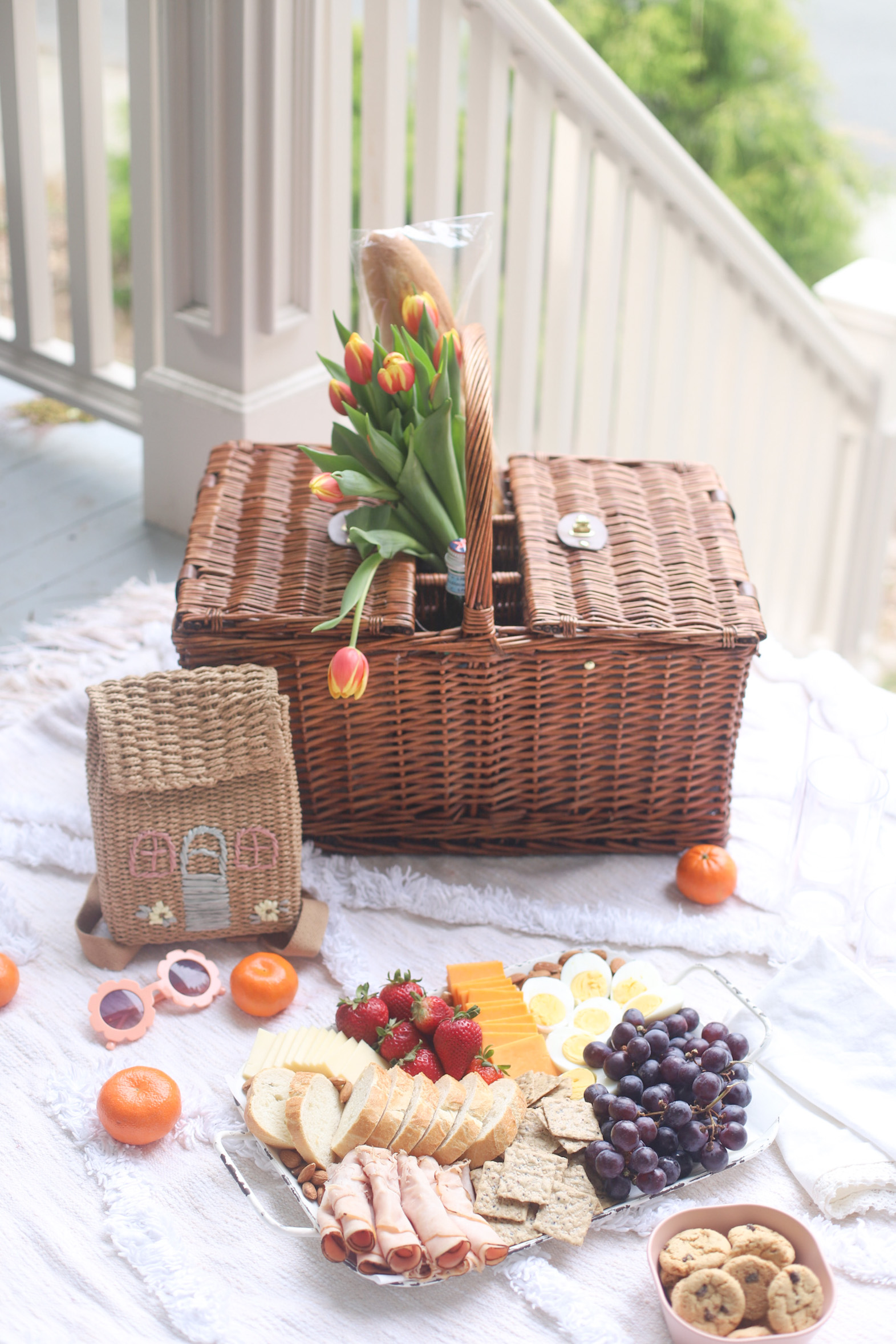 a picnic basket and a charcuterie board