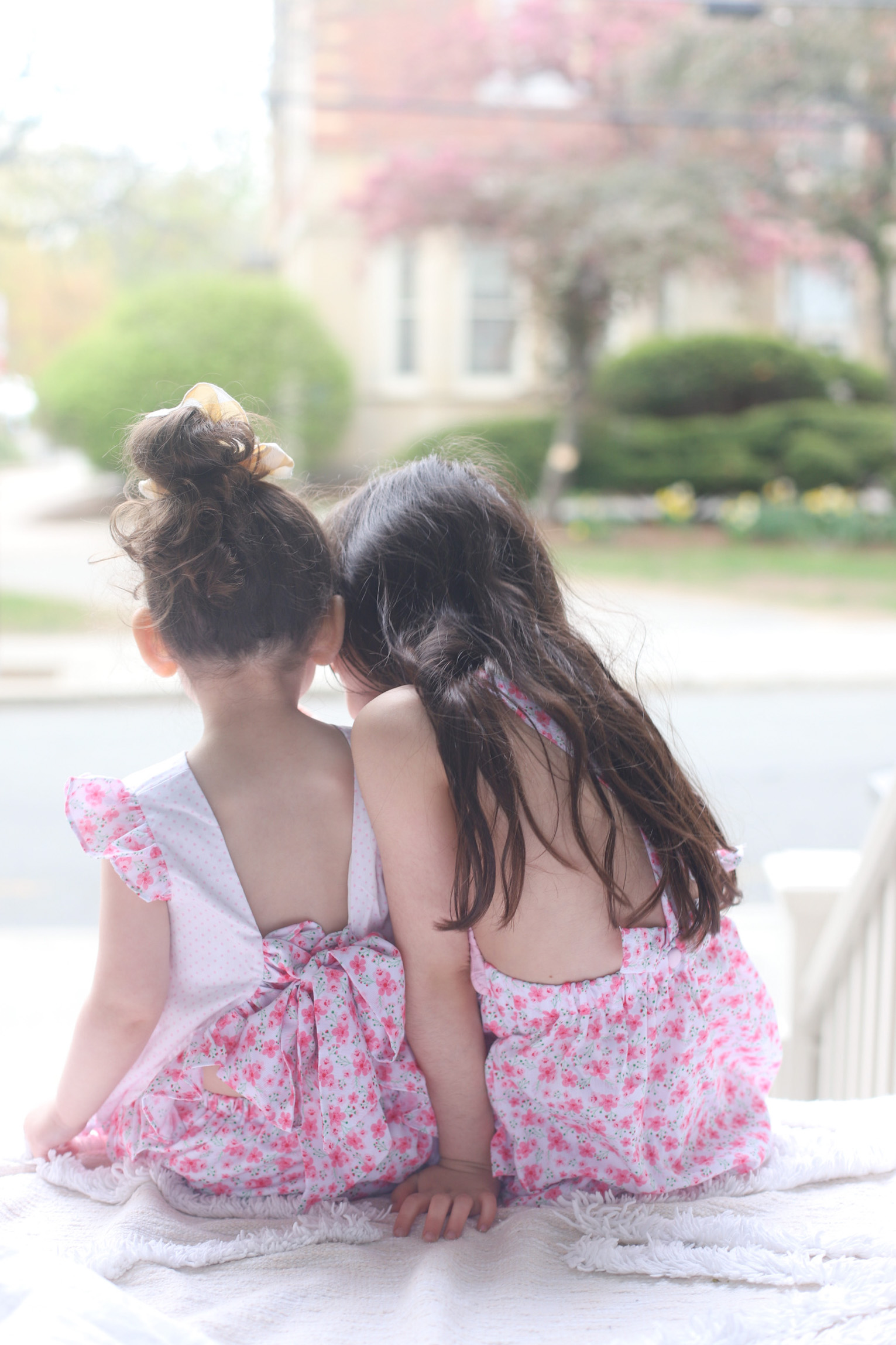 back of two kids facing the streets