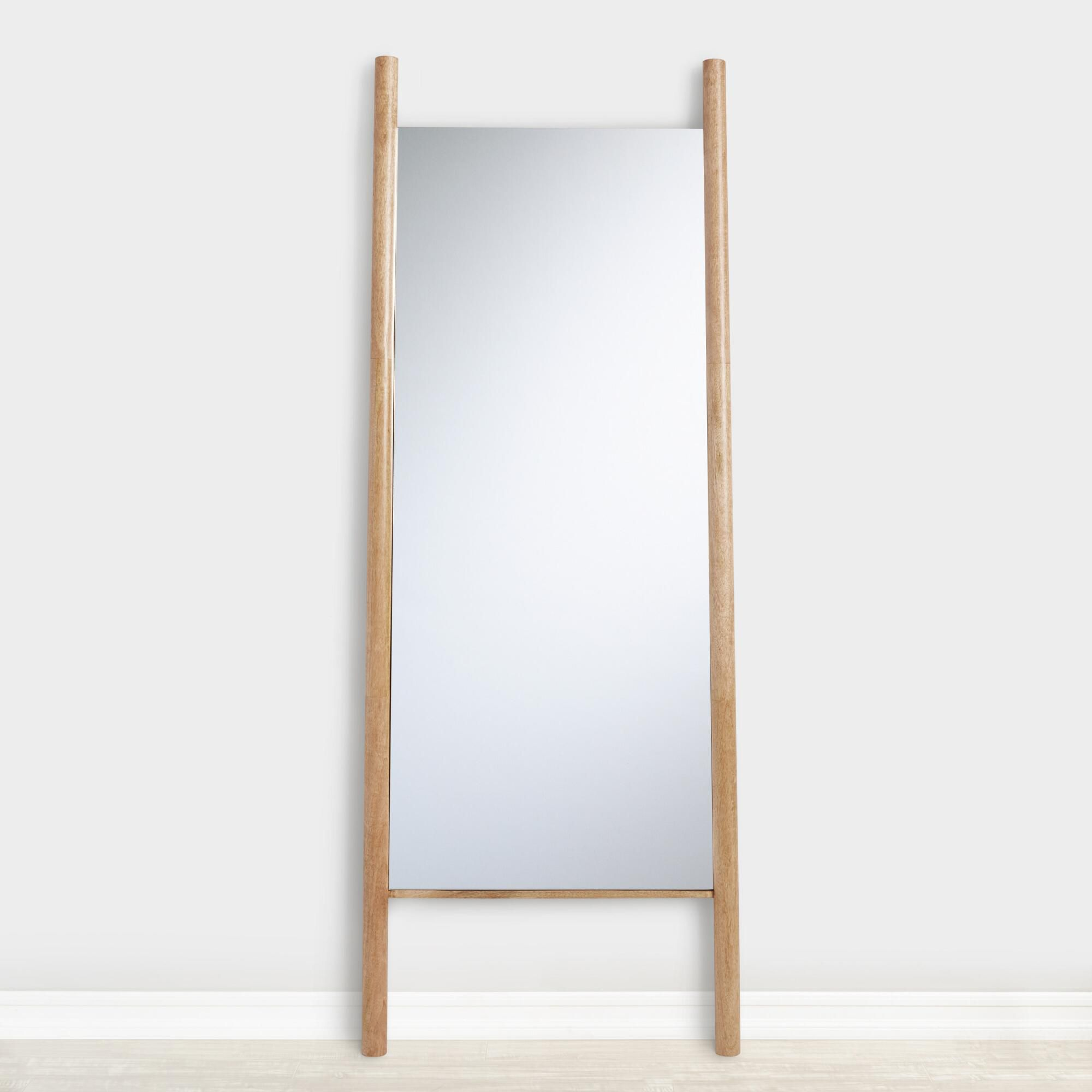 World Market Natural Wood Ladder Leaning Full Length Arya Mirror leaning on the wall