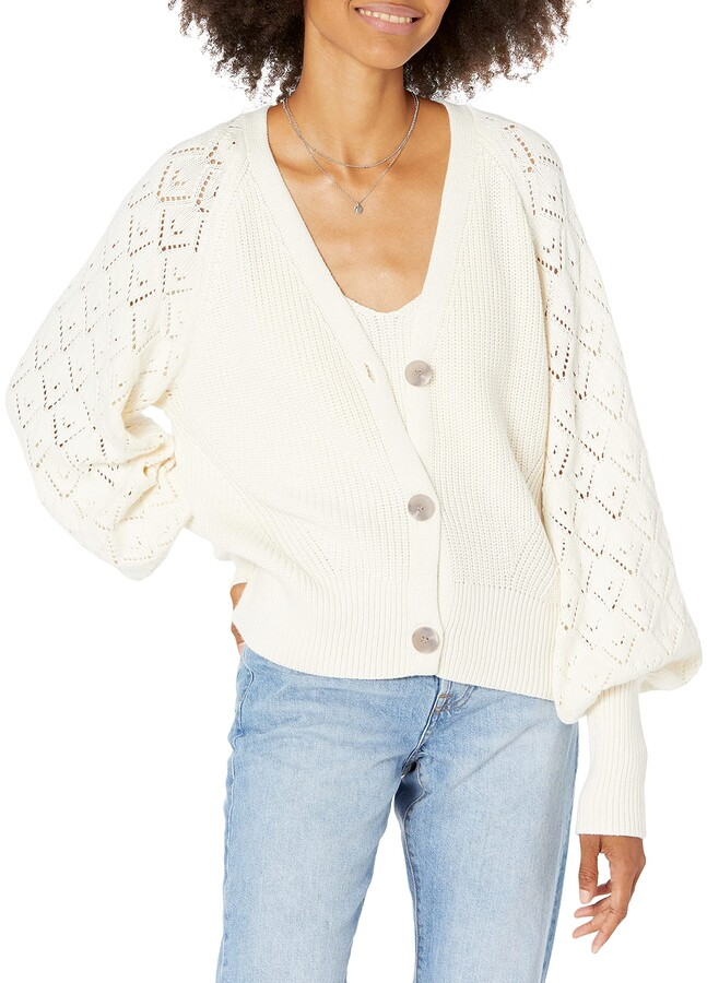 woman wearing The Drop Women's Divya Pointelle Full Sleeve Cardigan Sweater and denim jeans