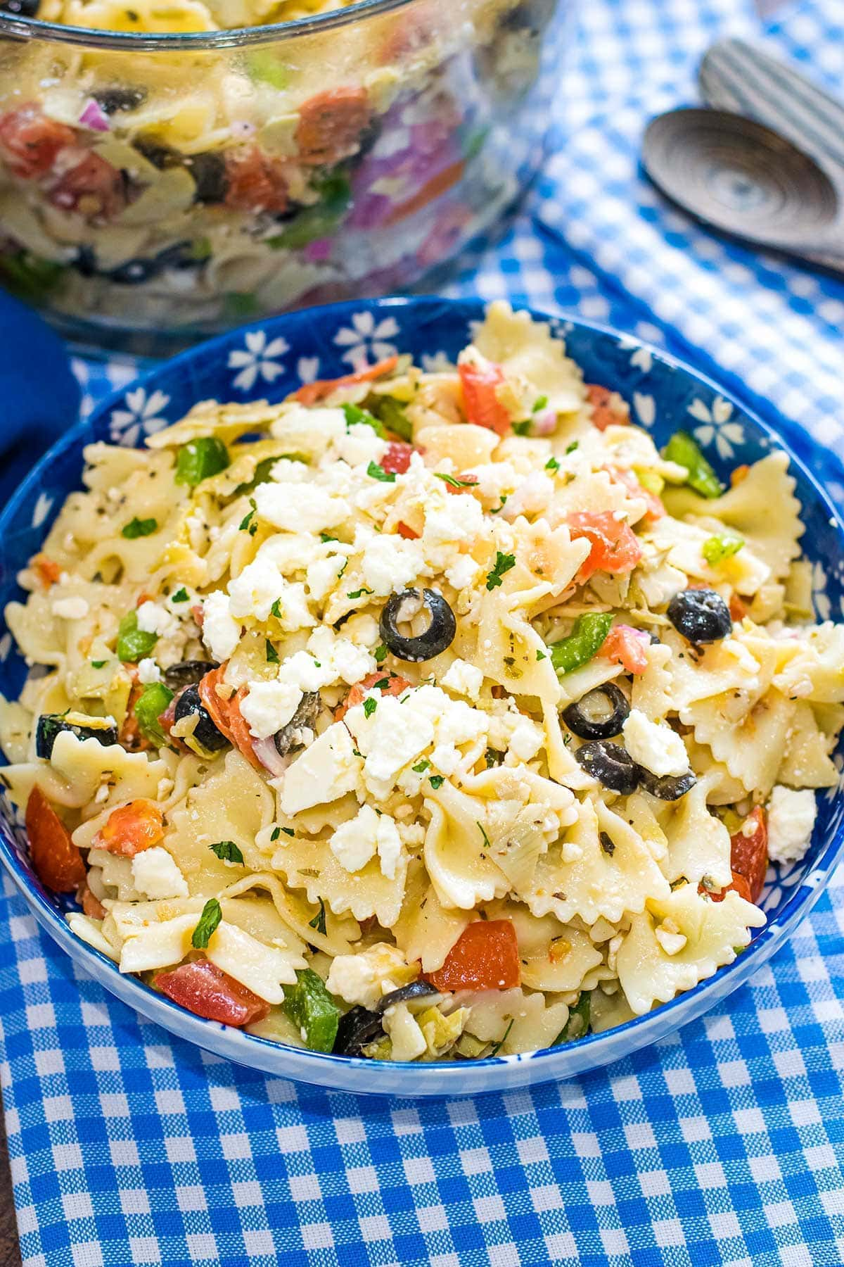 Pasta Salad with Artichoke Hearts and Feta on a blue bowl