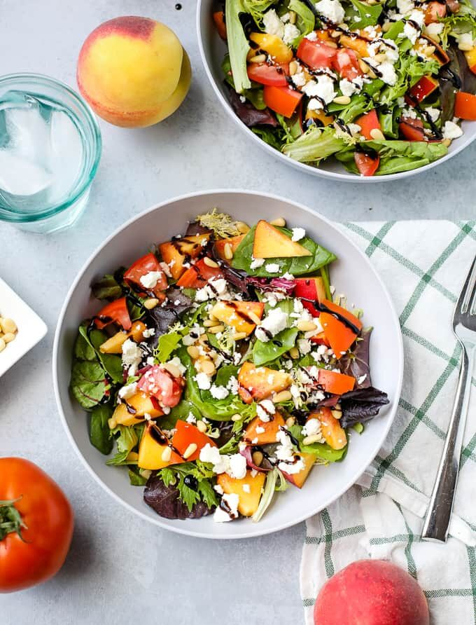Peach Salad with Feta and Pine Nuts on white plate for Incredible Summer Salad Recipes