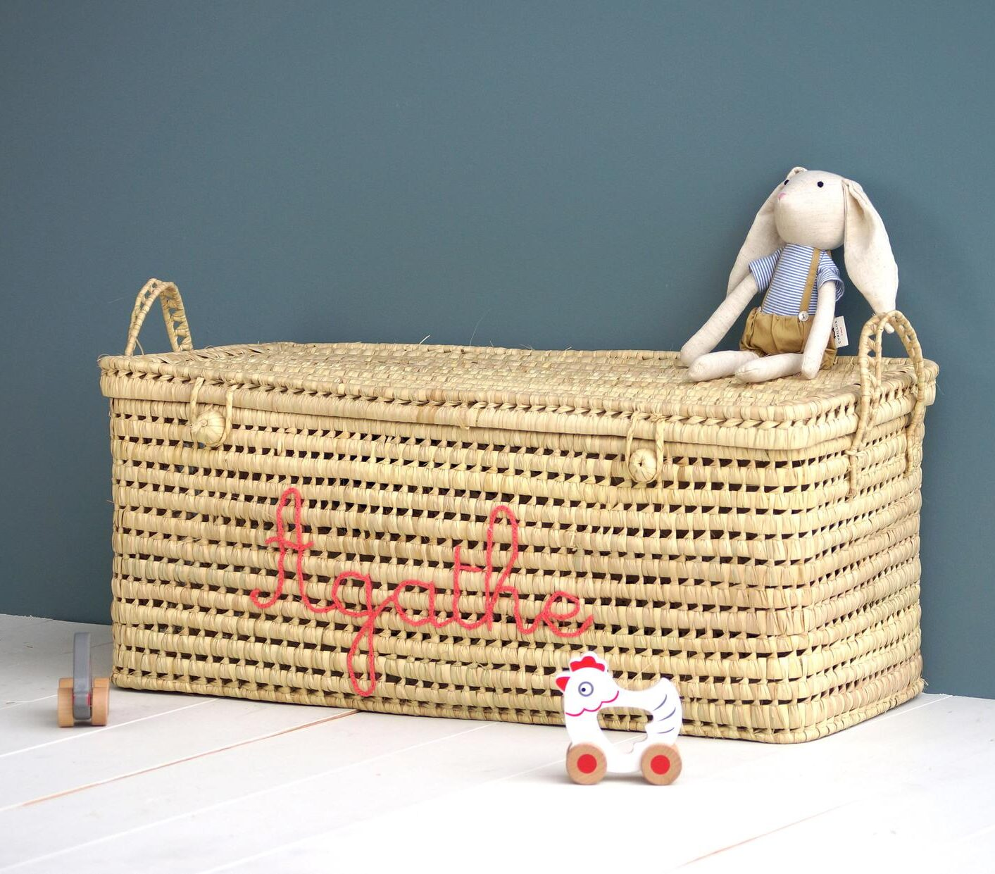 Personalized Palm Leaf Storage Toy Trunk - Rattan Basket with Lid, bunny stuffed toy, and wooden chicken toy for Summer Must-Haves
