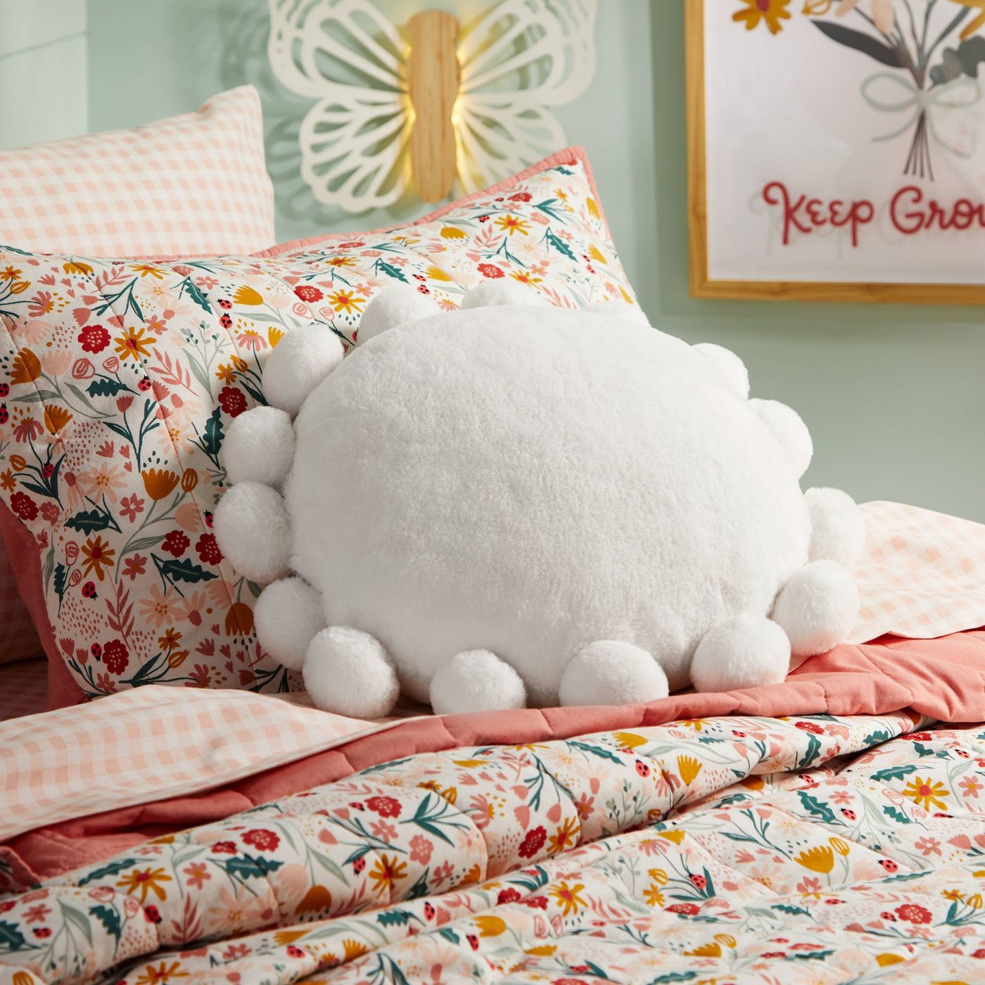 Pillowfort Round Plush Pillow with Poms-Poms on a pillow as summer accessories