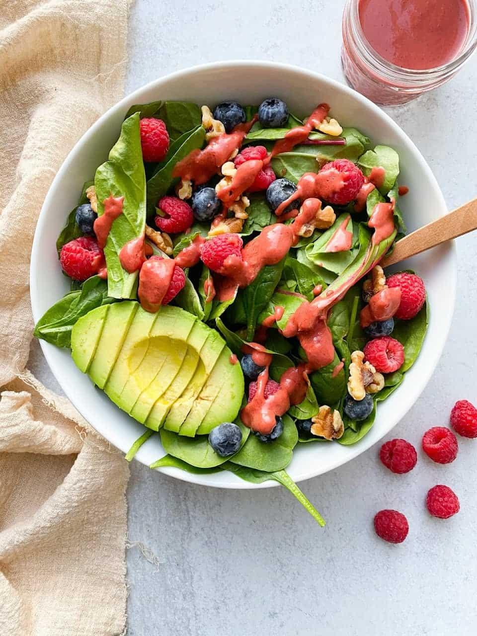 Berry Salad with Homemade Raspberry Vinaigrette on white serving bowl