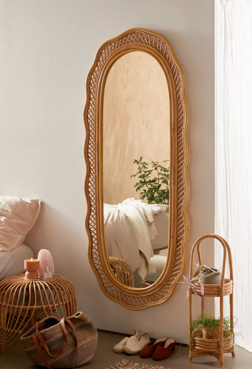 Urban Outfitters Malorie Wicker Wall Mirror , bag, shoes, in a bedroom for Summer Must-Haves
