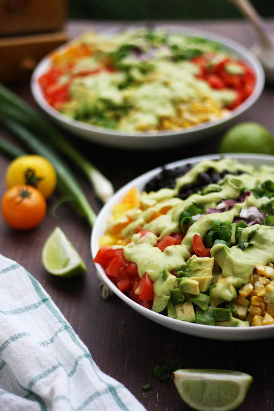 ingredients of Vegan Mexican Chopped Salad with Avocado Dressing on white plates