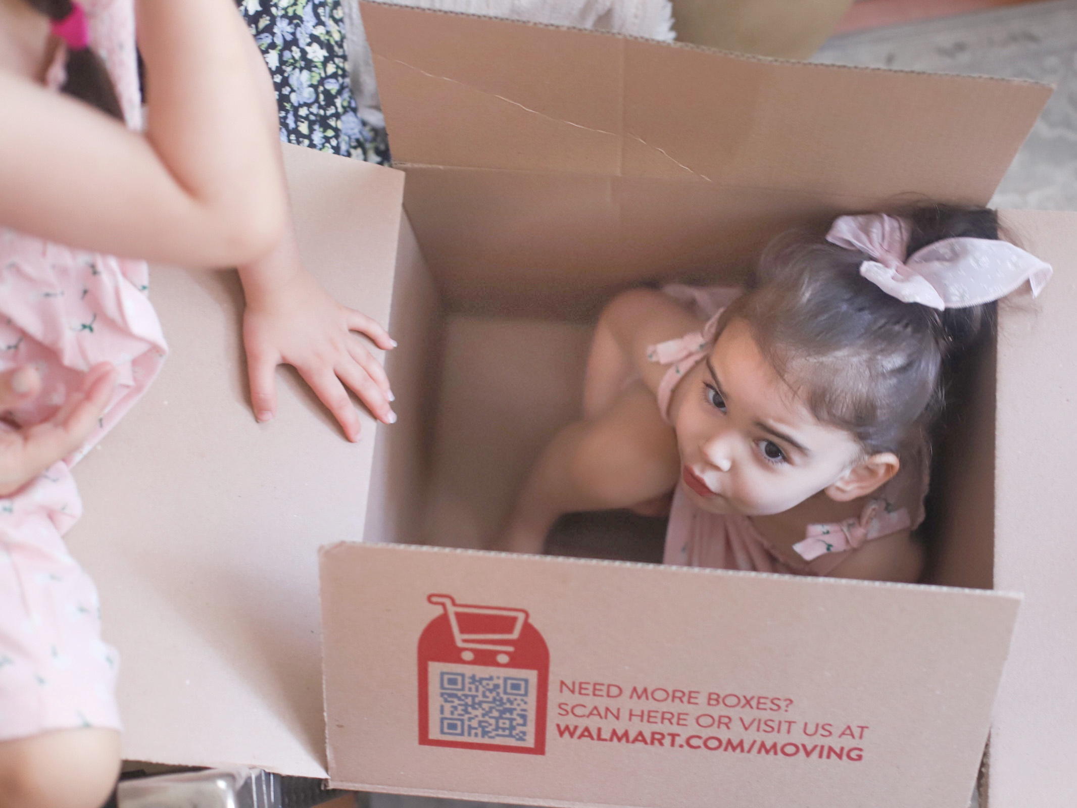 a child inside sitting inside a box for We Bought a House in Boston post