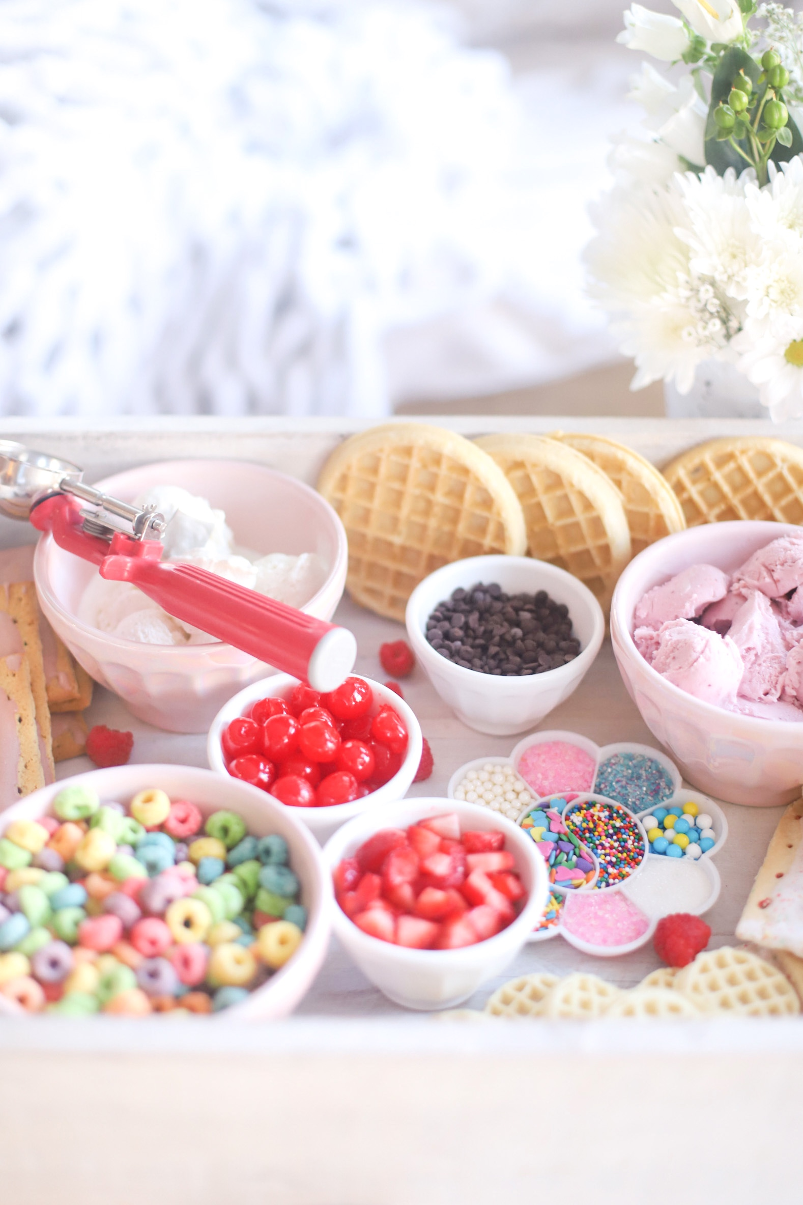 Create-Your-Own Ice Cream tray with ice cream and toppings
