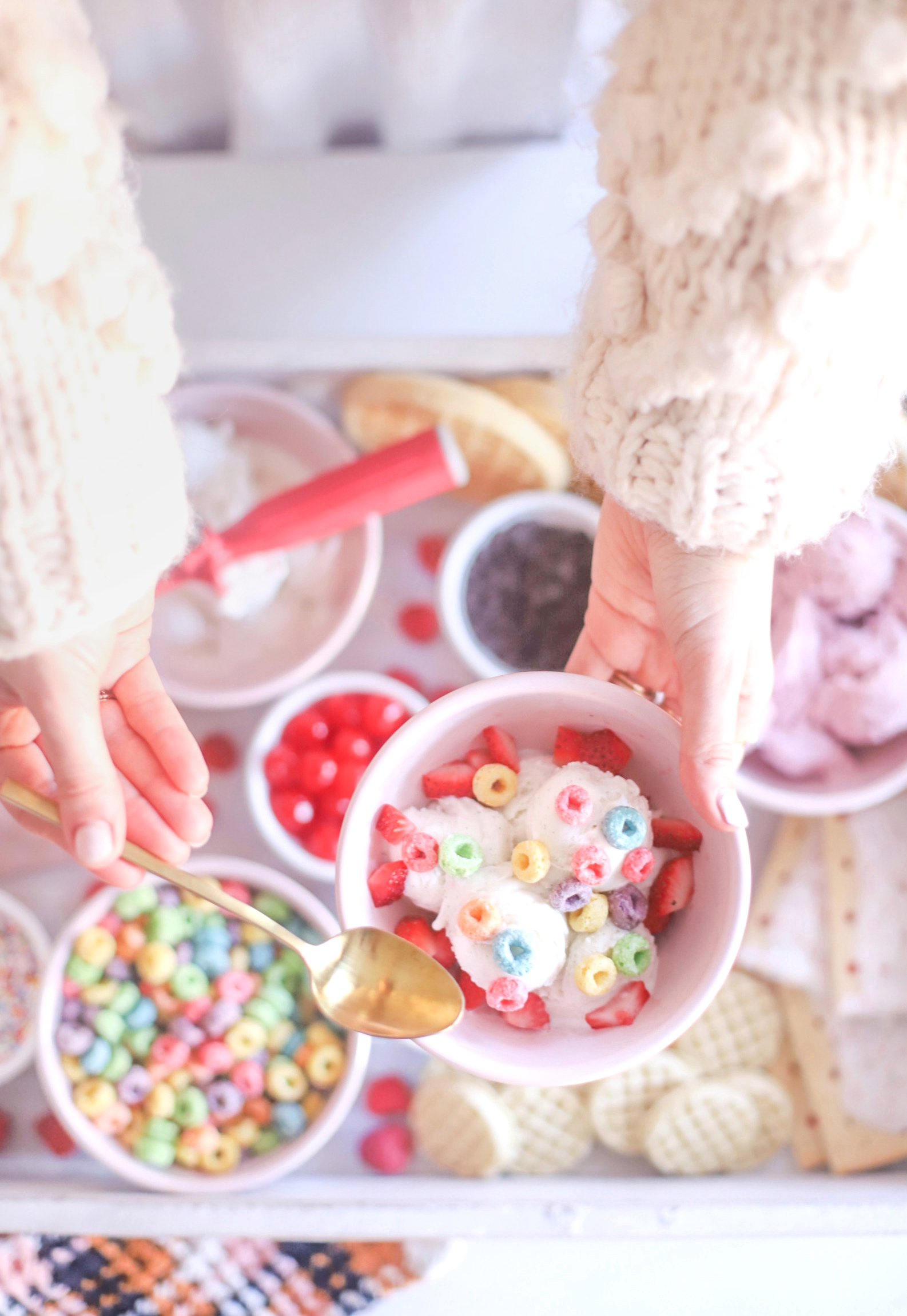 woman holding a dessert with toppings