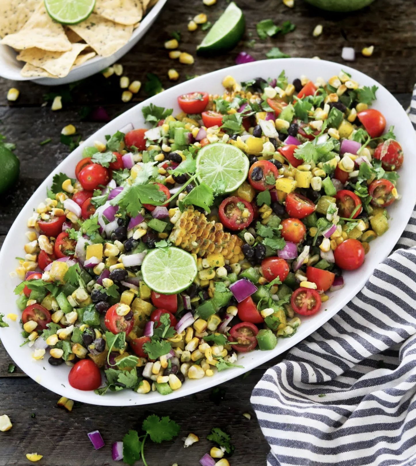SUMMER GRILLED CORN SALAD W/ CILANTRO LIME DRESSING on a white serving plate