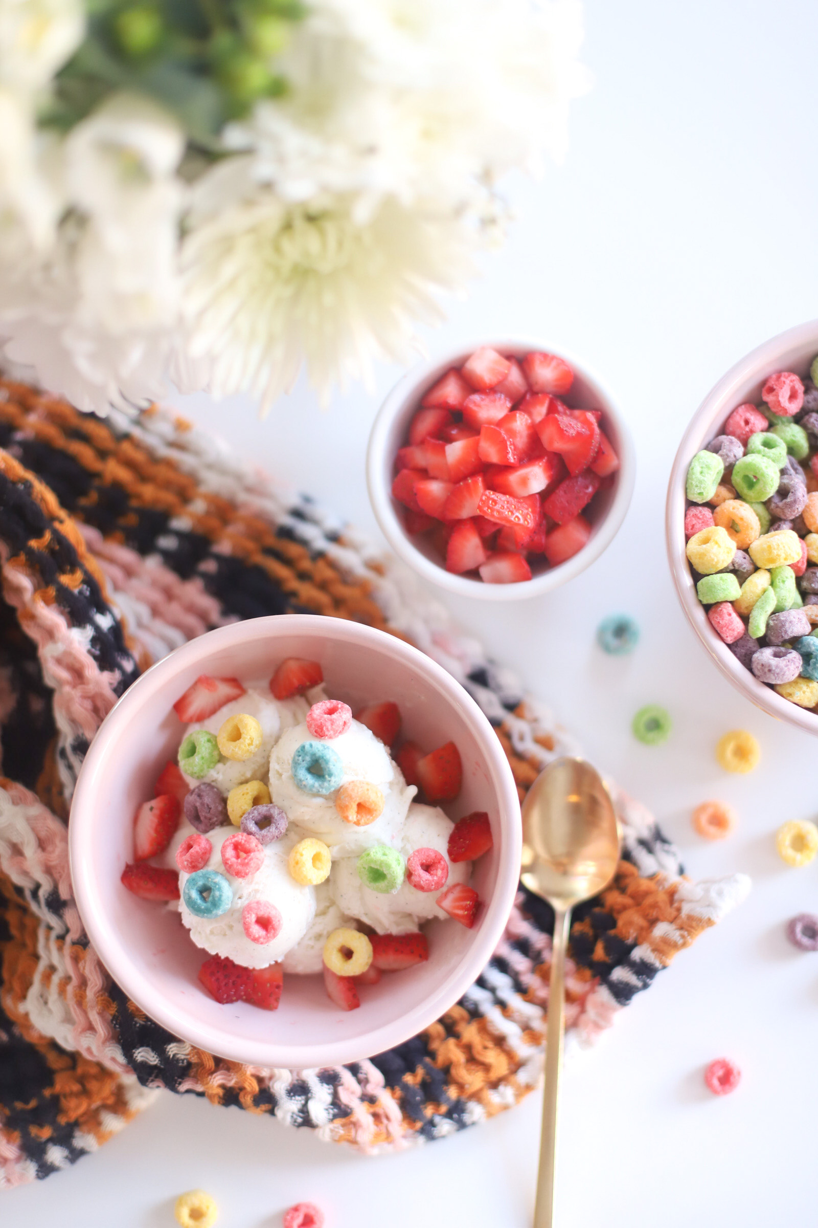 ice cream with toppings and toppings on a bowl