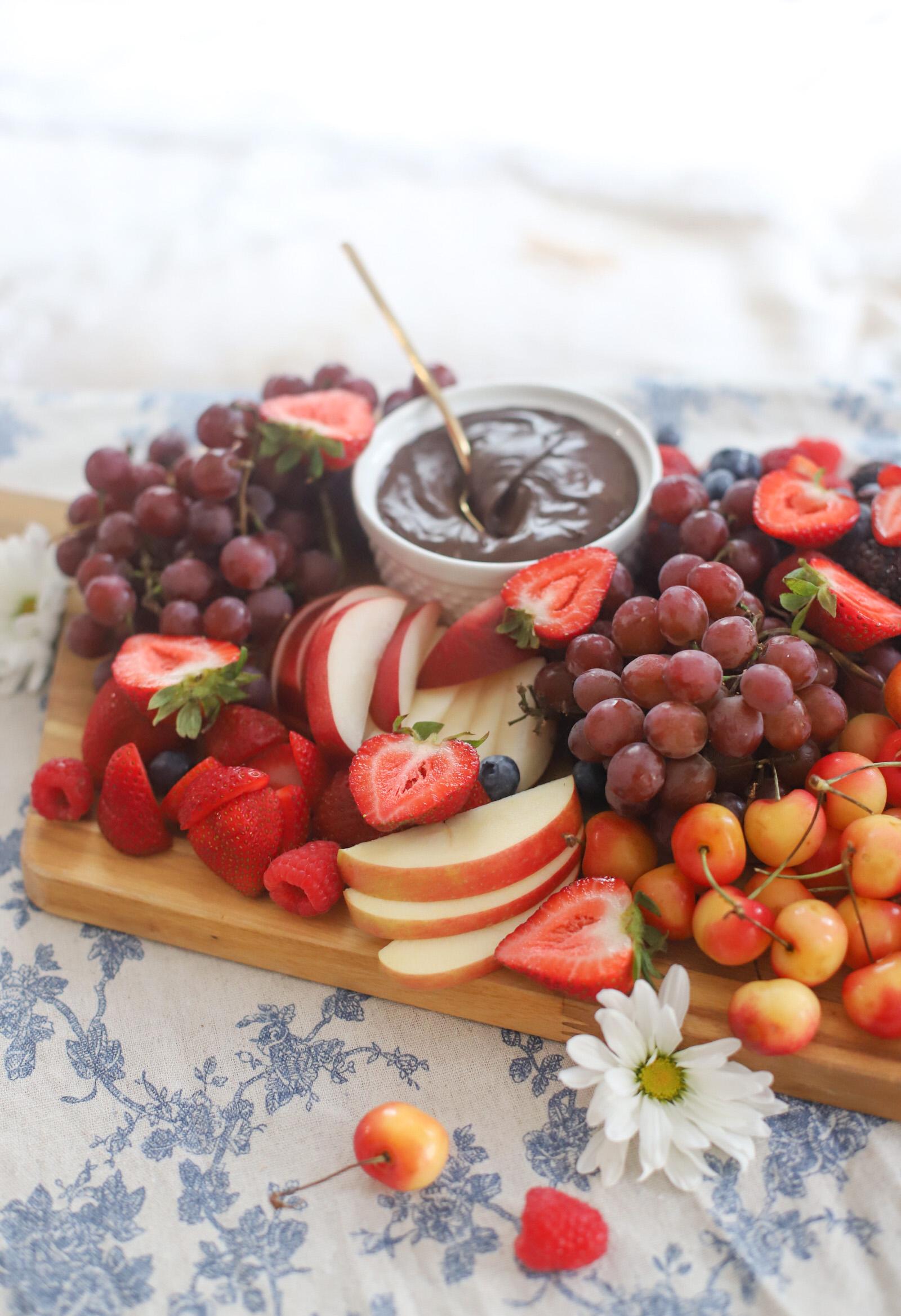 fruit dessert board with chocolate dip