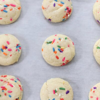 The softest sugar cookies with that perfect chewy center, packed with sprinkles; say hello to our very favorite dairy free sprinkle cookies! These pillowy soft cookies will quickly become your new favorite sugar cookie recipe! | @glitterinclexi | GLITTERINC.COM